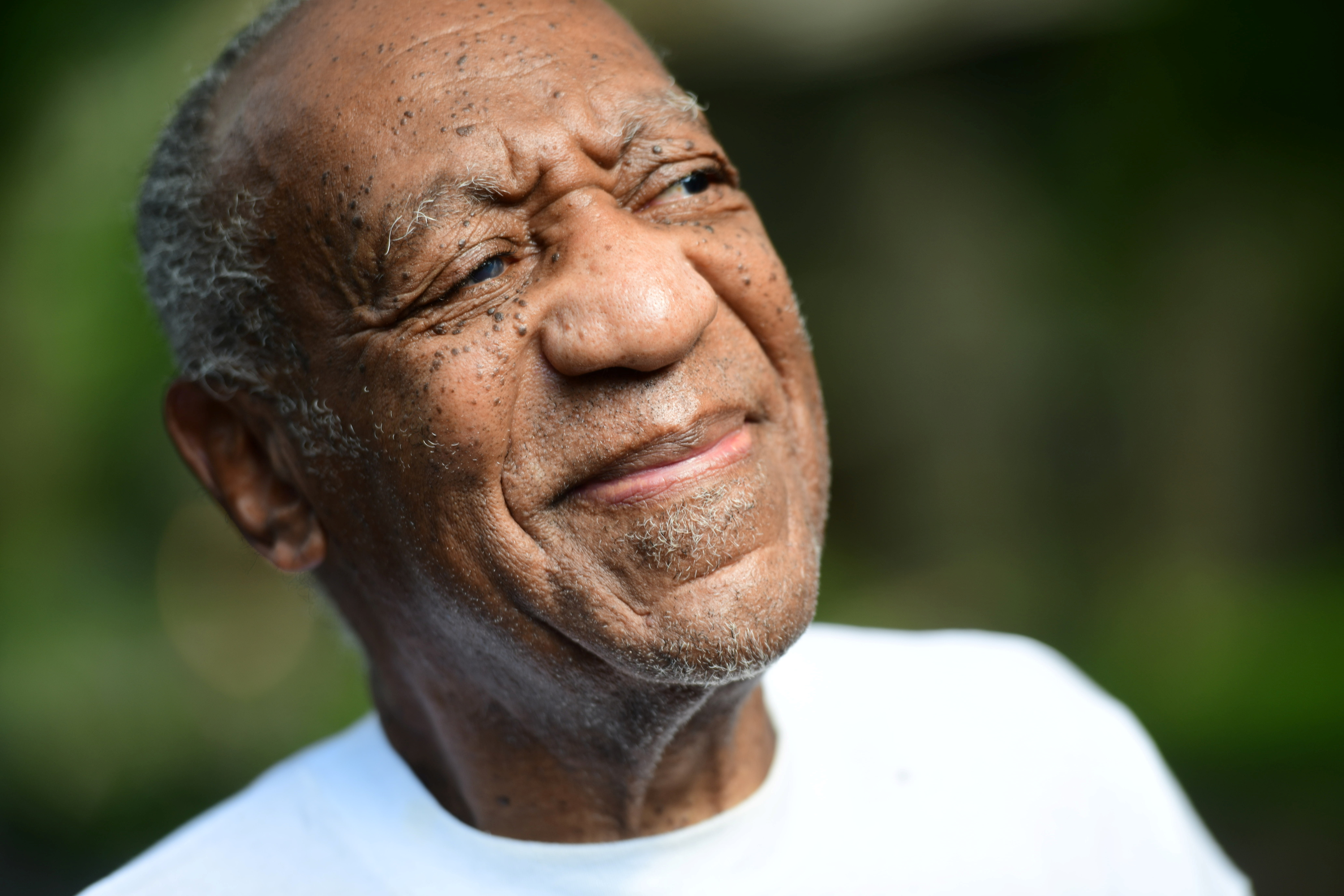 Bill Cosby looks on outside his house after Pennsylvania's highest court overturned his sexual assault conviction and ordered him released from prison immediately, in Elkins Park, Pennsylvania, U.S. June 30, 2021. REUTERS/Mark Makela