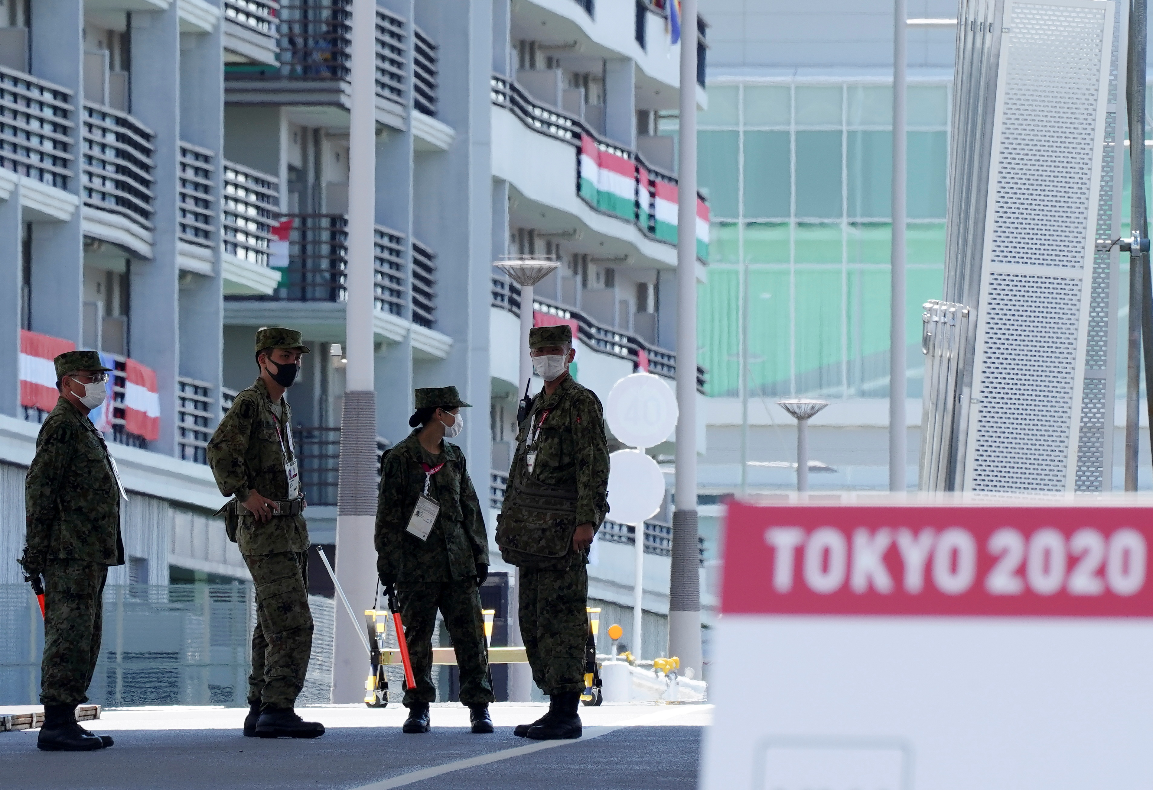 Japan Self-Defense Forces soldiers stand guard at the athletes' village for the Tokyo 2020 Olympic Games, in Tokyo, Japan, July 22, 2021. REUTERS/Naoki Ogura