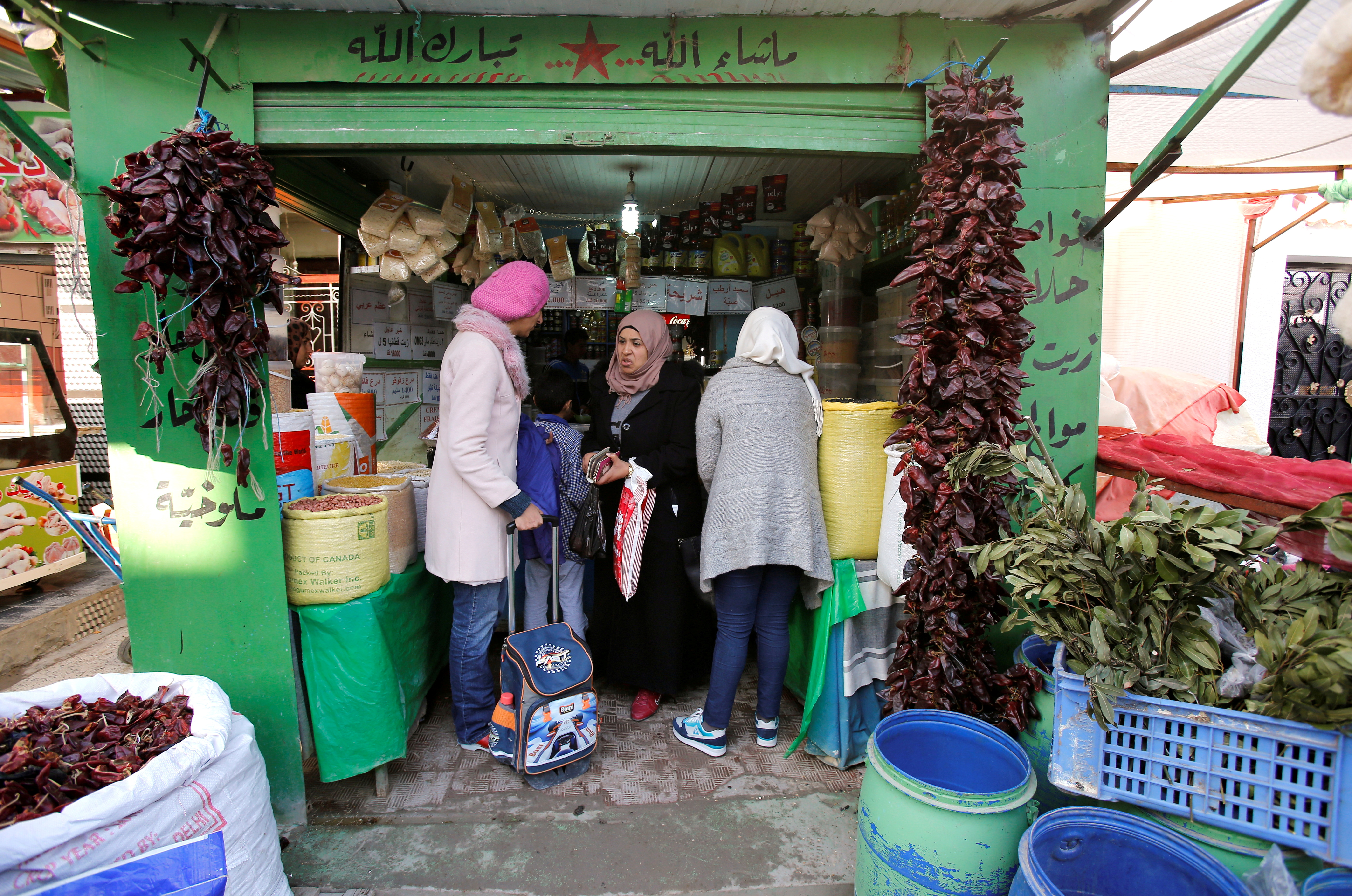People shop at a Tadamun market in the outskirts of Tunis, Tunisia January 15, 2018. REUTERS/Youssef Boudlal/File Photo