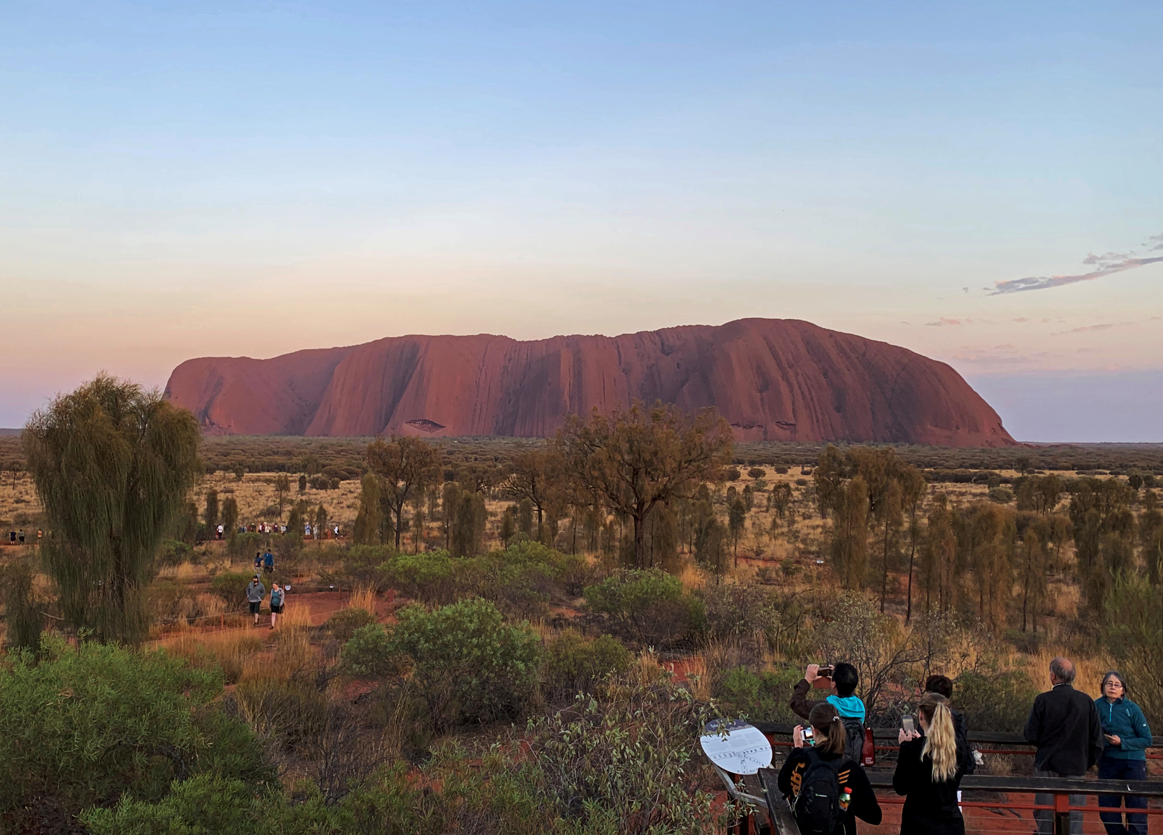 People view Uluru, formerly known as Ayers Rock, the day before a permanent ban on climbing the monolith takes effect following a decades-long fight by indigenous people to close the trek, near Yulara, Australia, October 25, 2019.  REUTERS/Stefica Bikes/File Photo - RC2O8M9GWMBB