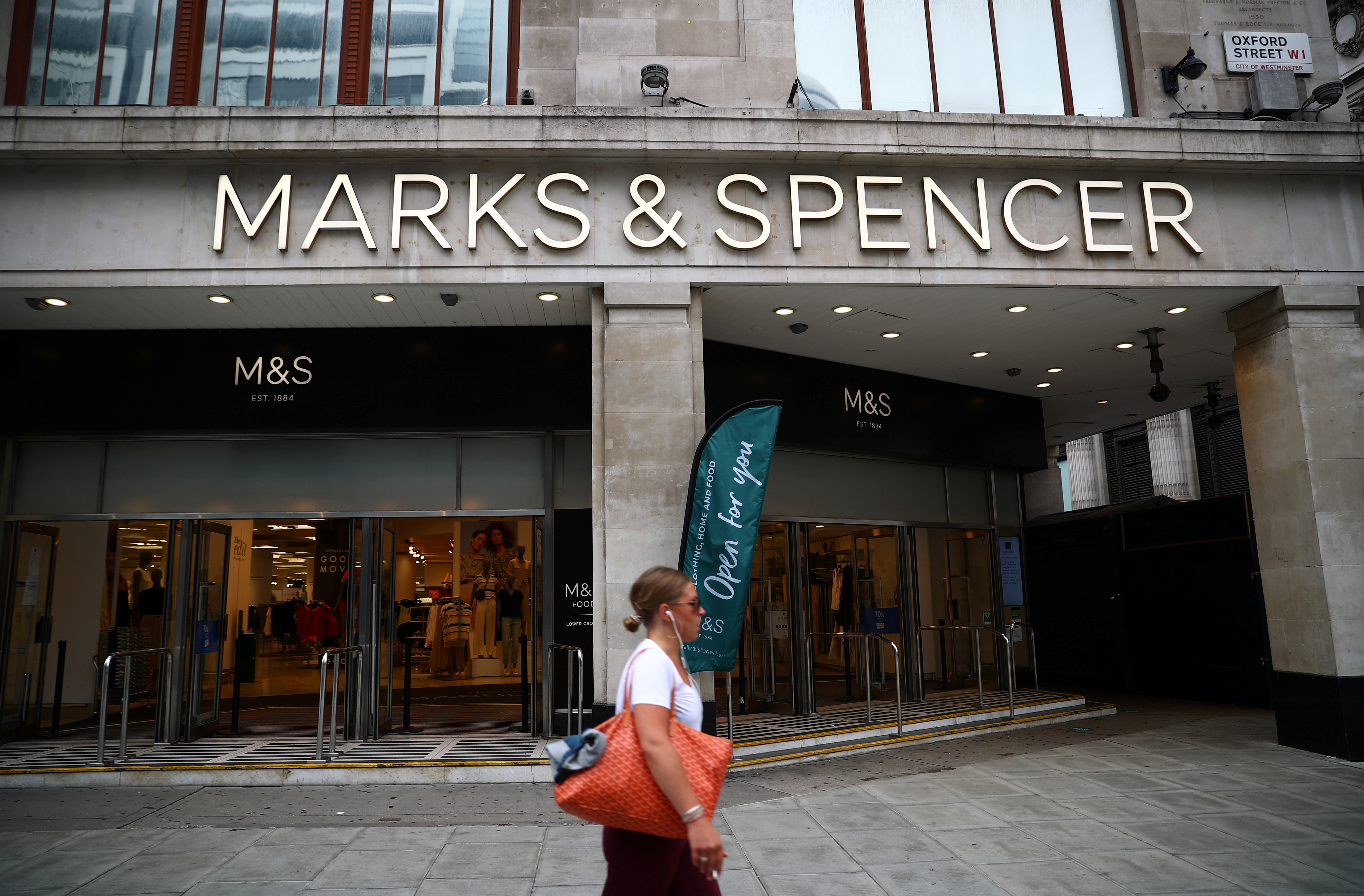 An entrance to a Marks and Spencer store is pictured at the Oxford Street, in London, Britain July 2, 2020. REUTERS/Hannah McKay/File Photo