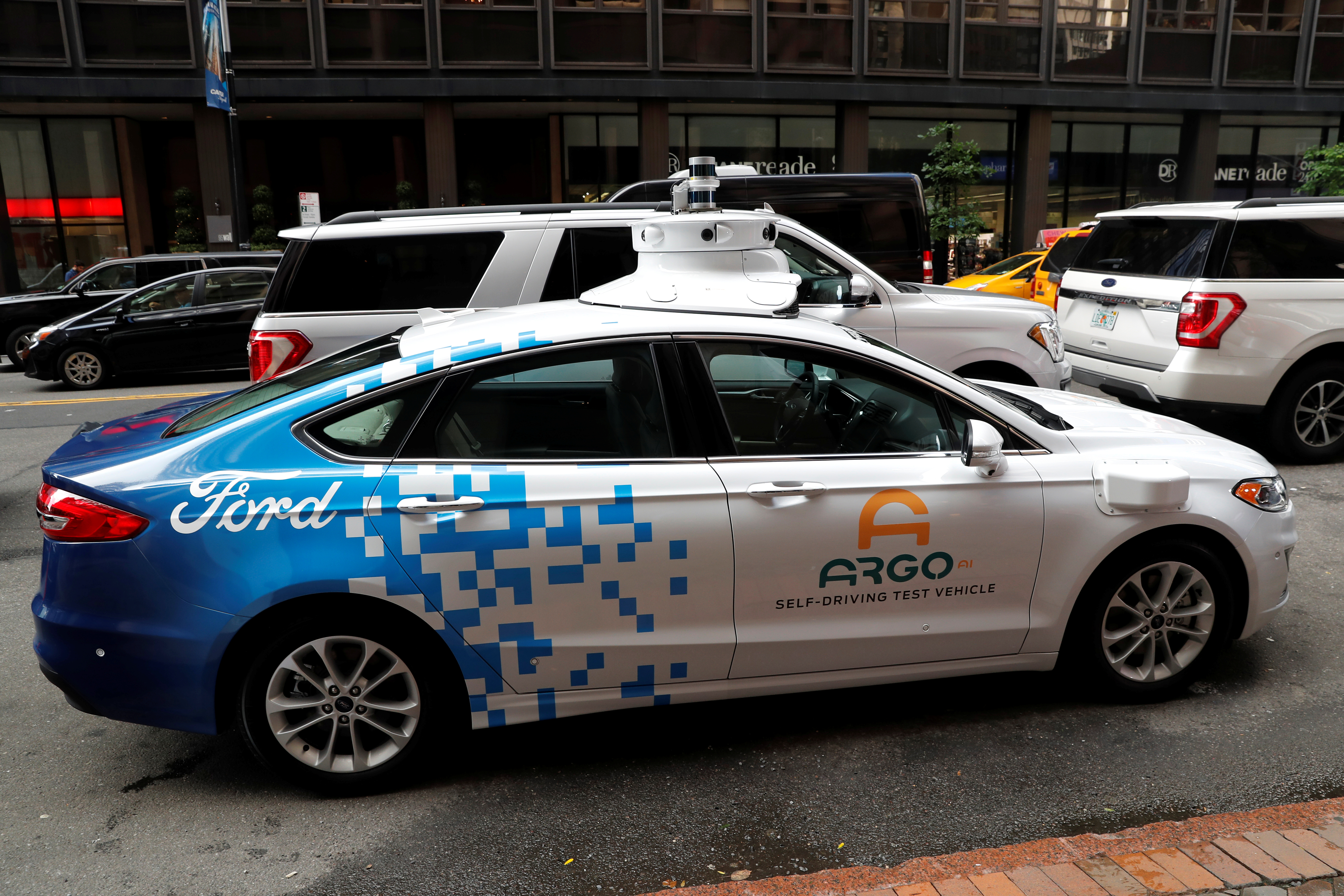 An Argo Ai self driving prototype vehicle is seen outside a Ford and Volkswagen joint news conference in New York City, New York, U.S., July 12, 2019. REUTERS/Mike Segar/Files