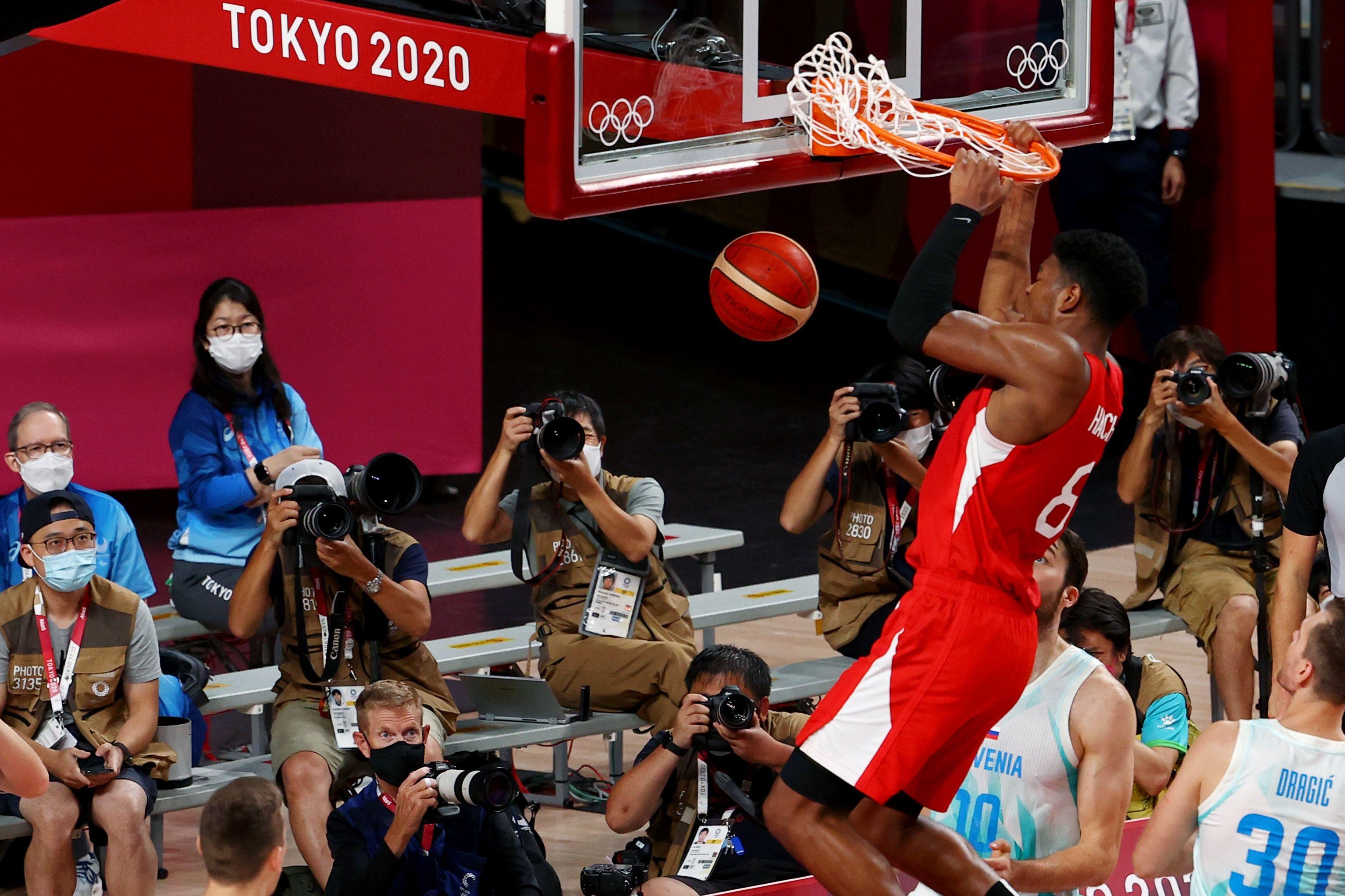 Tokyo 2020 Olympics - Basketball - Men - Group C - Slovenia v Japan - Saitama Super Arena, Saitama, Japan - July 29, 2021. Rui Hachimura of Japan scores a basket REUTERS/Brian Snyder