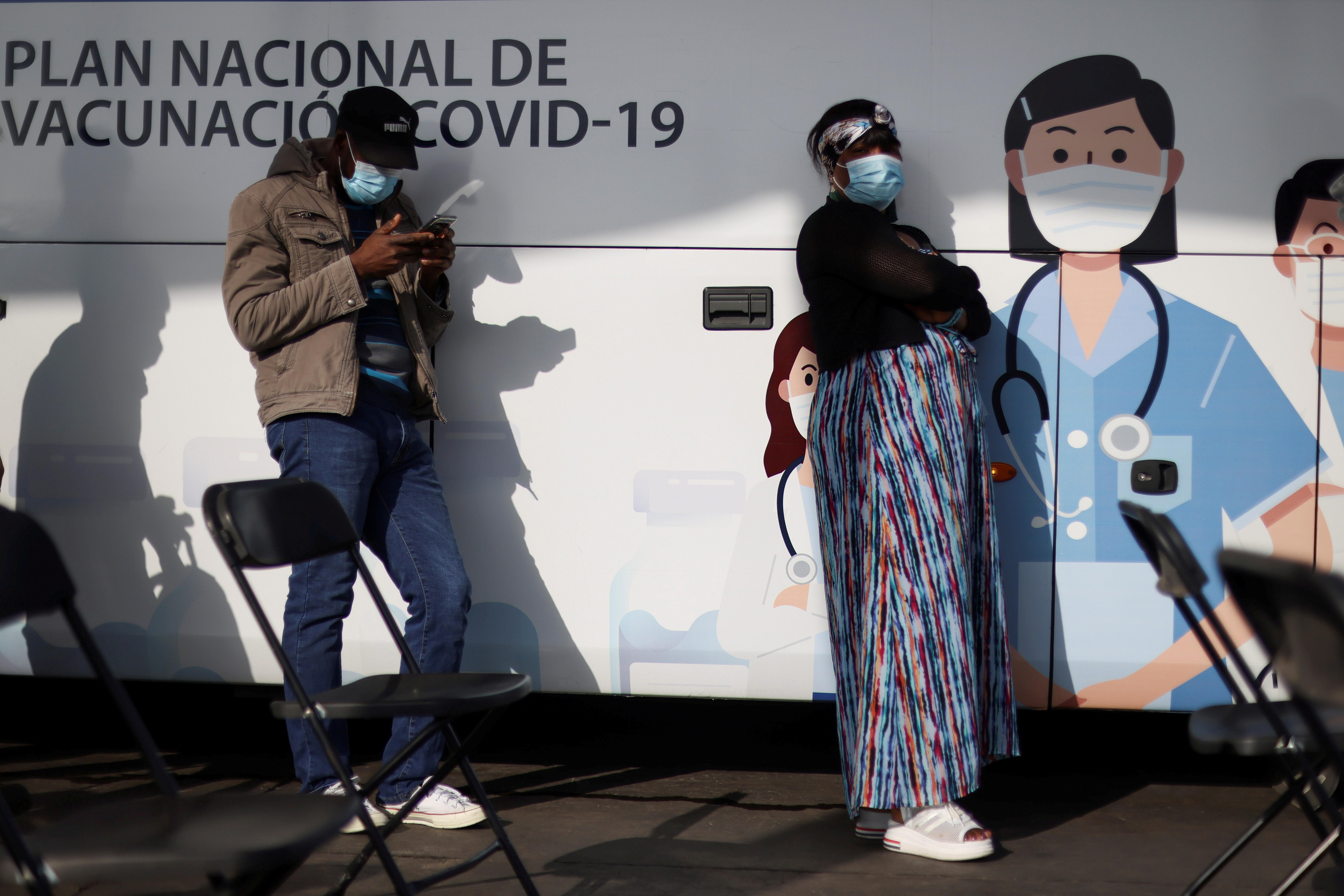 People wait outside a mobile vaccination centre to receive a dose of Sinovac's CoronaVac vaccine against the coronavirus disease (COVID-19) in Santiago, Chile June 16, 2021. REUTERS/Ivan Alvarado