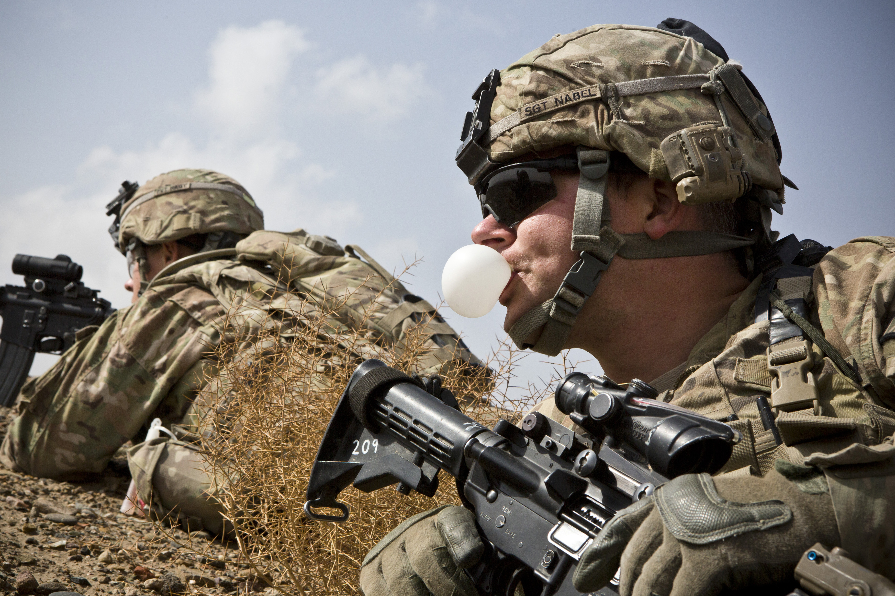 A U.S. Army soldier with Charlie Company, 36th Infantry Regiment, 1st Armored Division blows a bubble with his chewing gum during a mission near Command Outpost Pa'in Kalay in Maiwand District, Kandahar Province February 3, 2013. REUTERS/Stringer