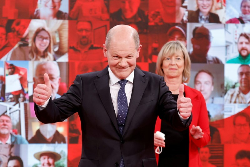 German Social Democratic Party (SPD) candidate for chancellor Olaf Scholz cheers on stage during a party meeting in Berlin, Germany, May 9, 2021. REUTERS/Axel Schmidt/Pool/File Photo