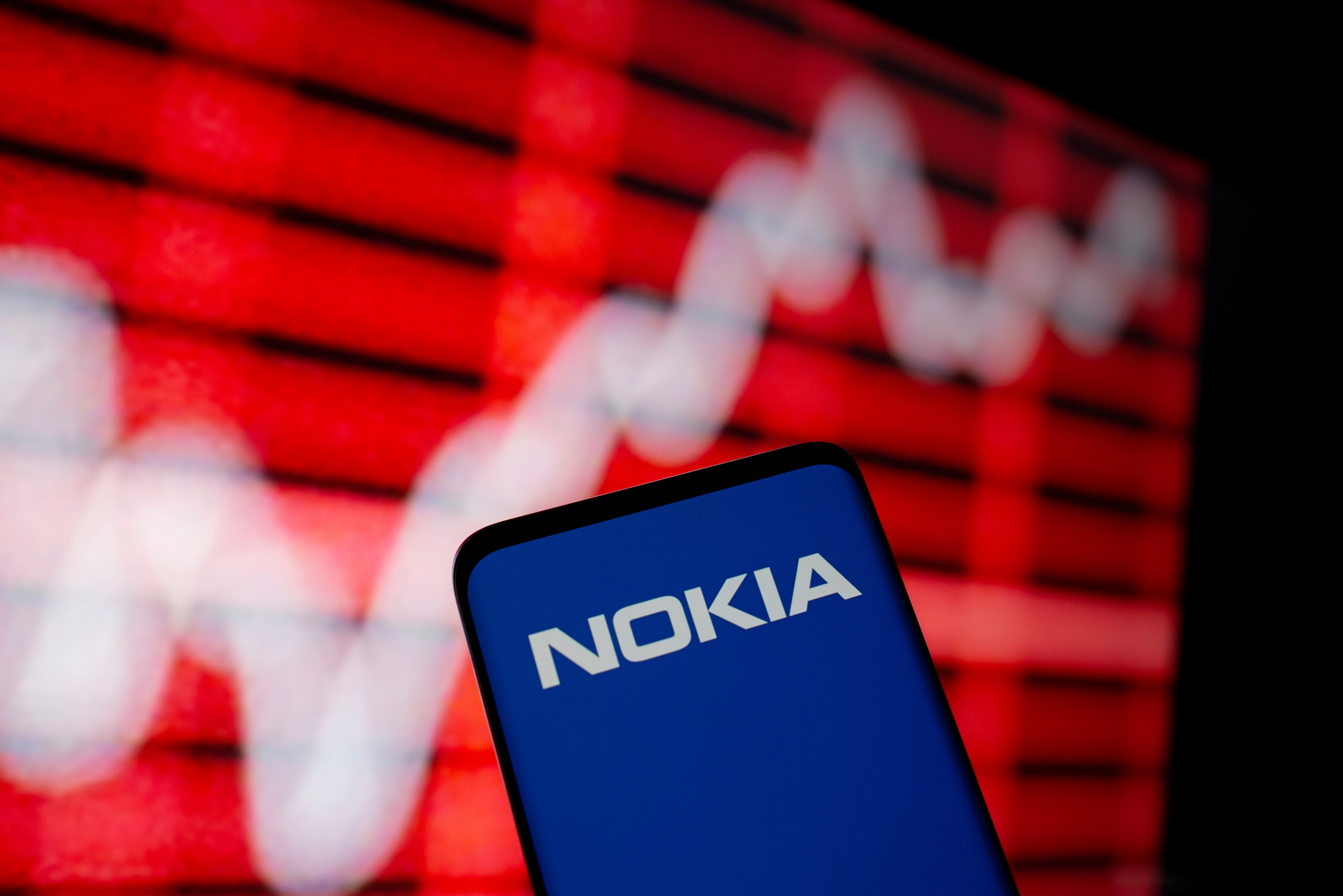 The Nokia logo is seen on a smartphone in front of a displayed stock graph in this illustration taken February 5, 2021. REUTERS/Dado Ruvic/Illustration/File Photo