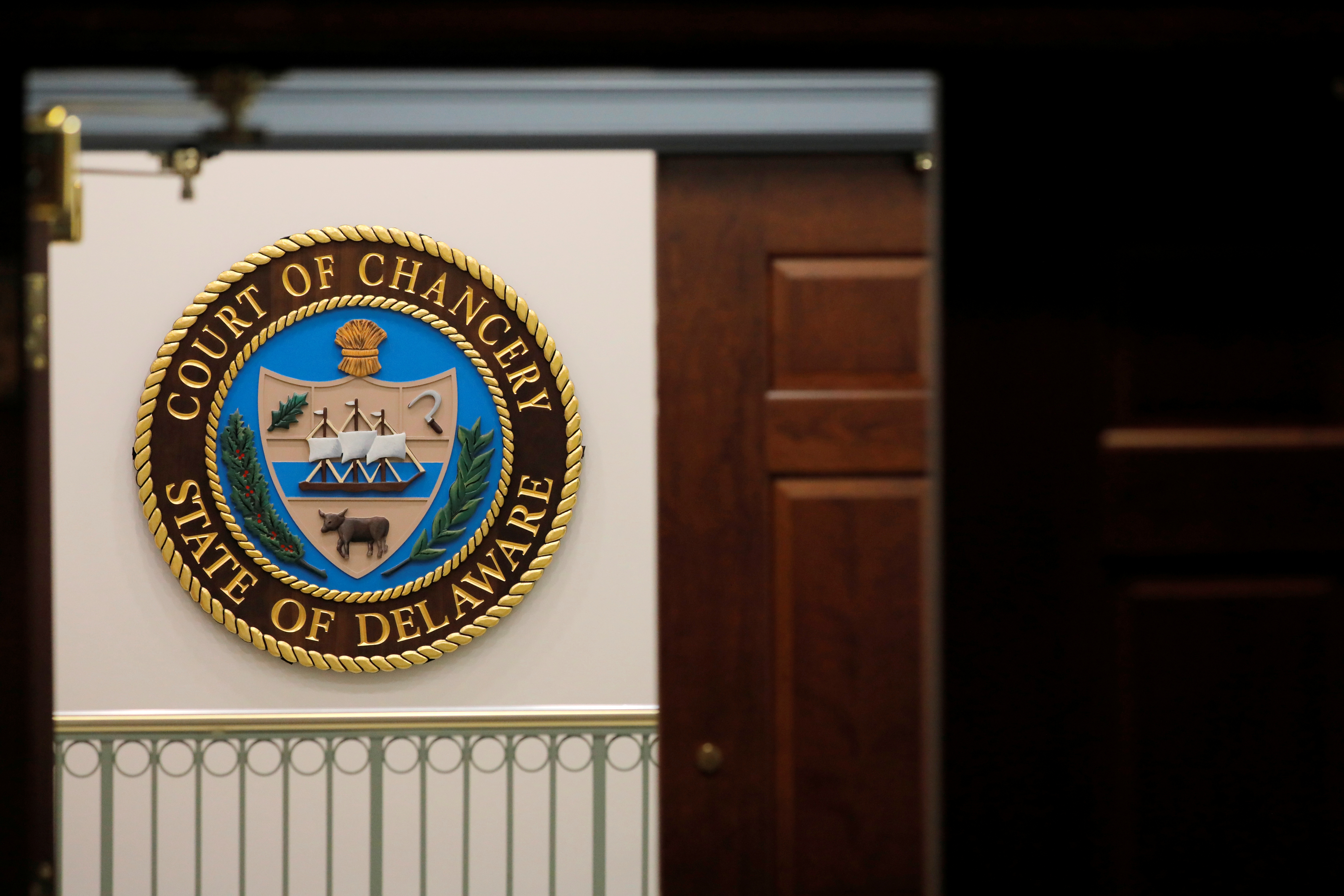 The seal of the Court of Chancery for the State of Delaware is seen on a wall in the Sussex County Court of Chancery in Georgetown, Delaware. REUTERS/Andrew Kelly