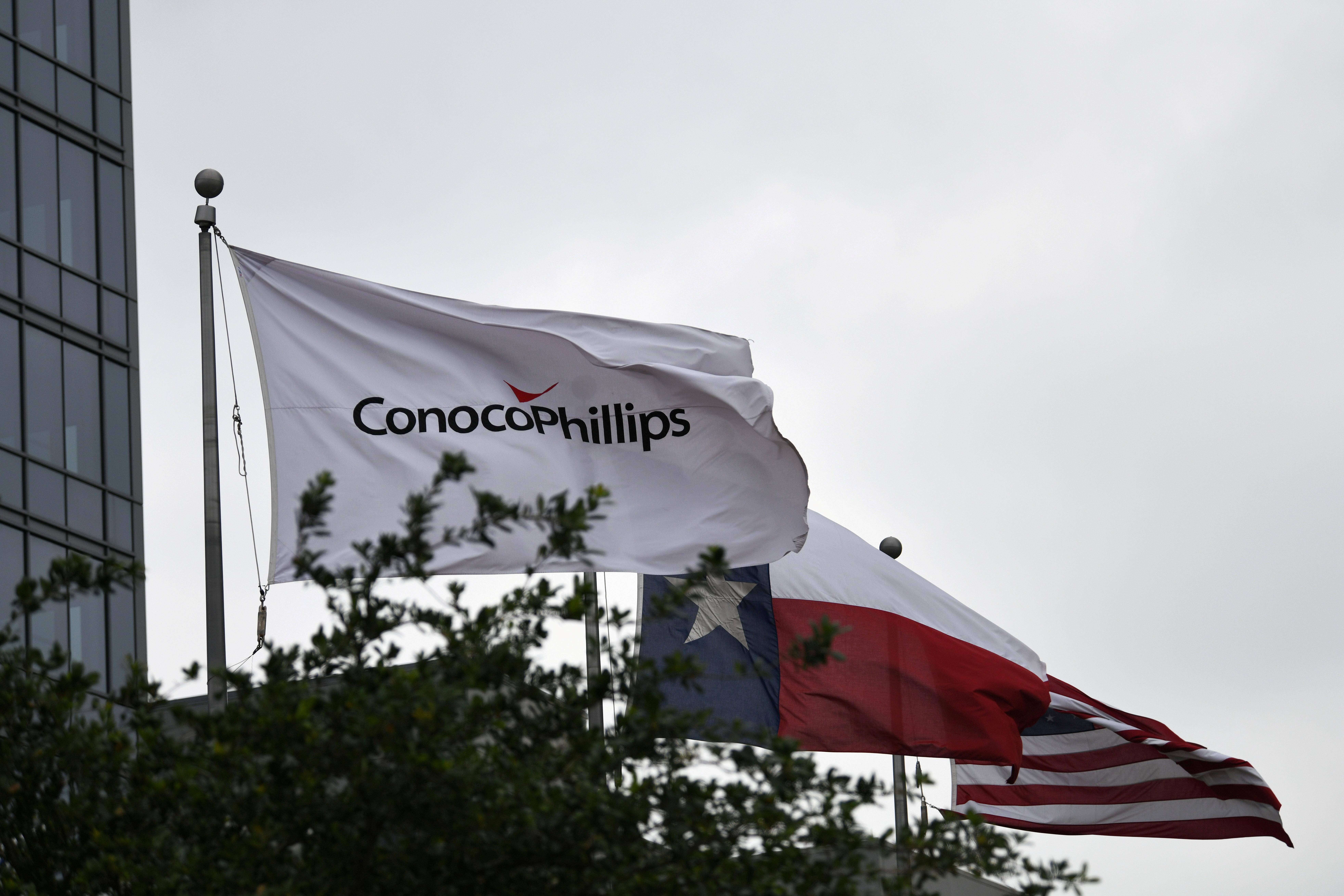 Flags fly outside ConocoPhillips offices in Houston, Texas, U.S., April 30, 2019.  REUTERS/Loren Elliott