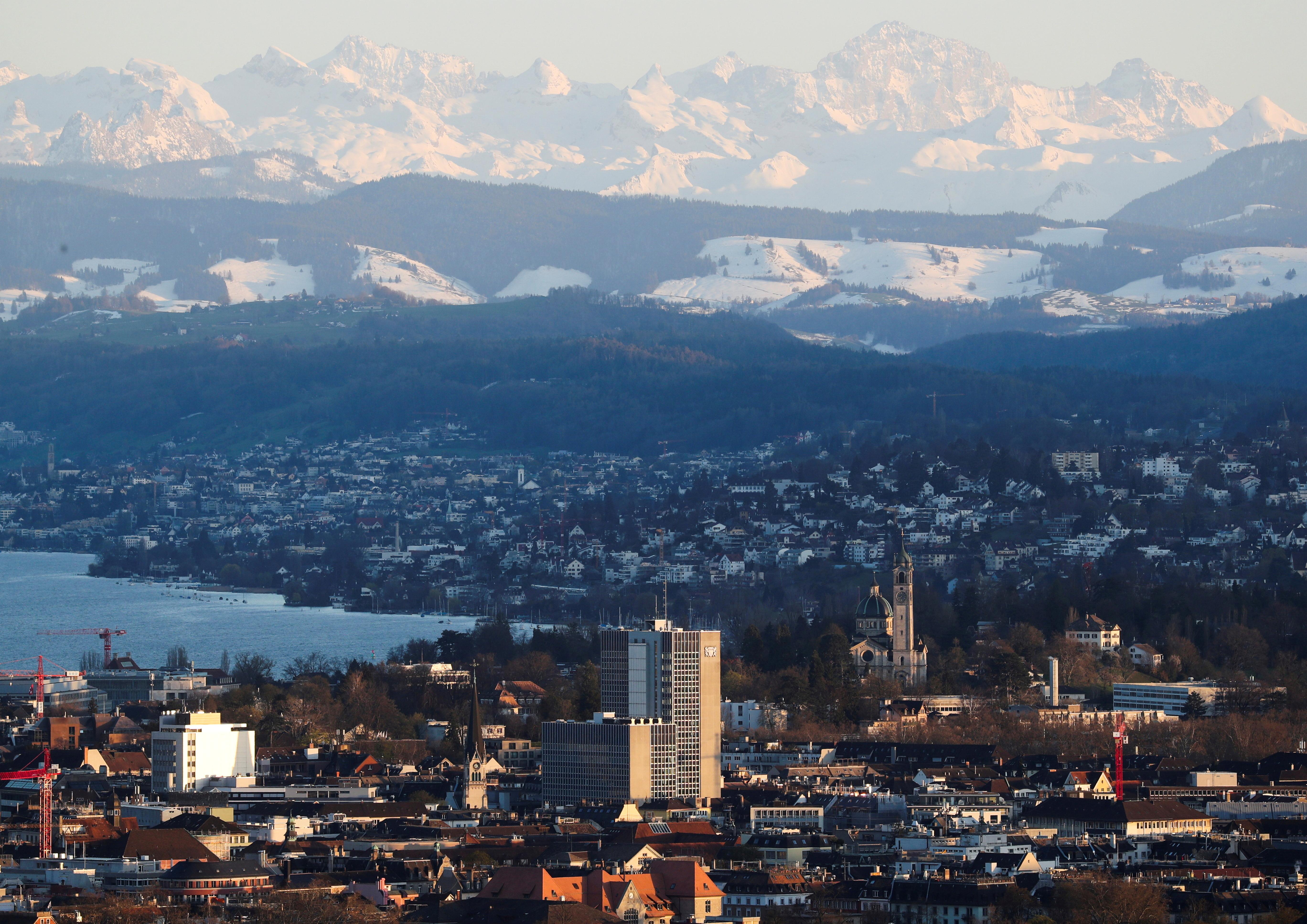 The Verwaltungszentrum Werd administration center is seen in front of the eastern Swiss Alps and Lake Zurich in Zurich, Switzerland, April 8, 2021.  REUTERS/Arnd Wiegmann