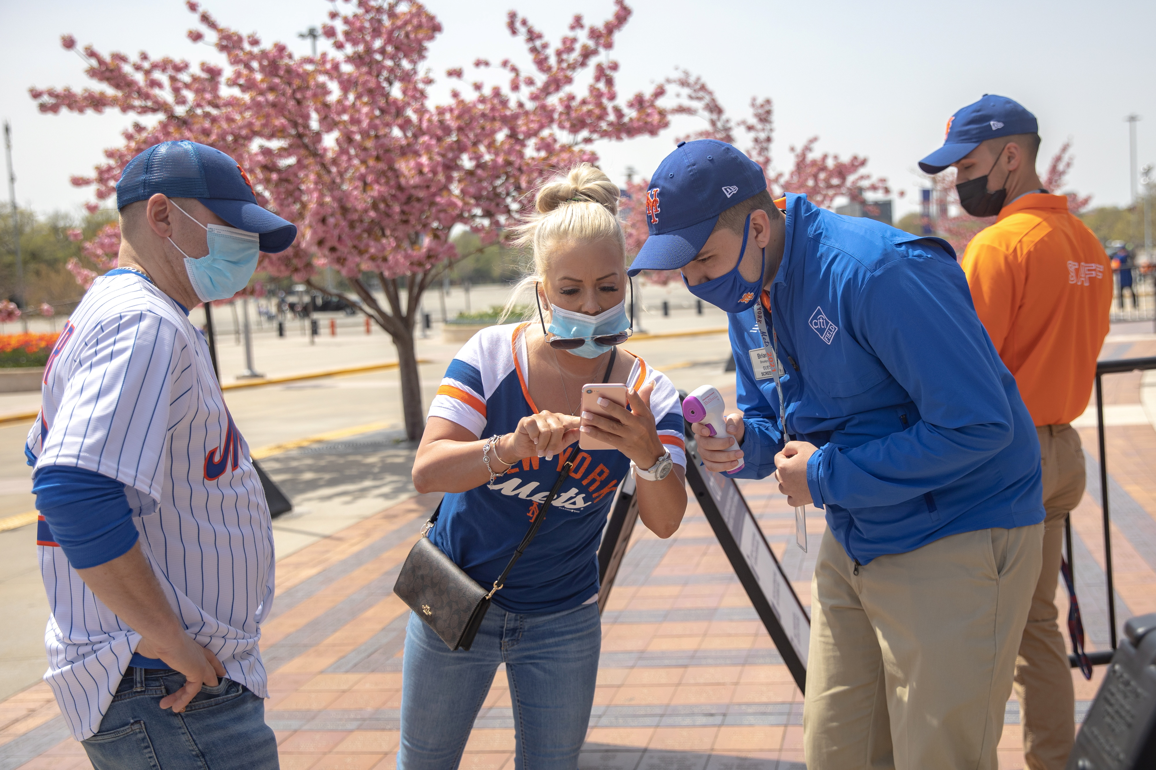 A fan shows a vaccine passport on her phone as she arrives for a New York Mets game, during the coronavirus disease (COVID-19) pandemic, at Citi Field in the Queens borough of New York City, U.S., April 24, 2021. REUTERS/Jeenah Moon