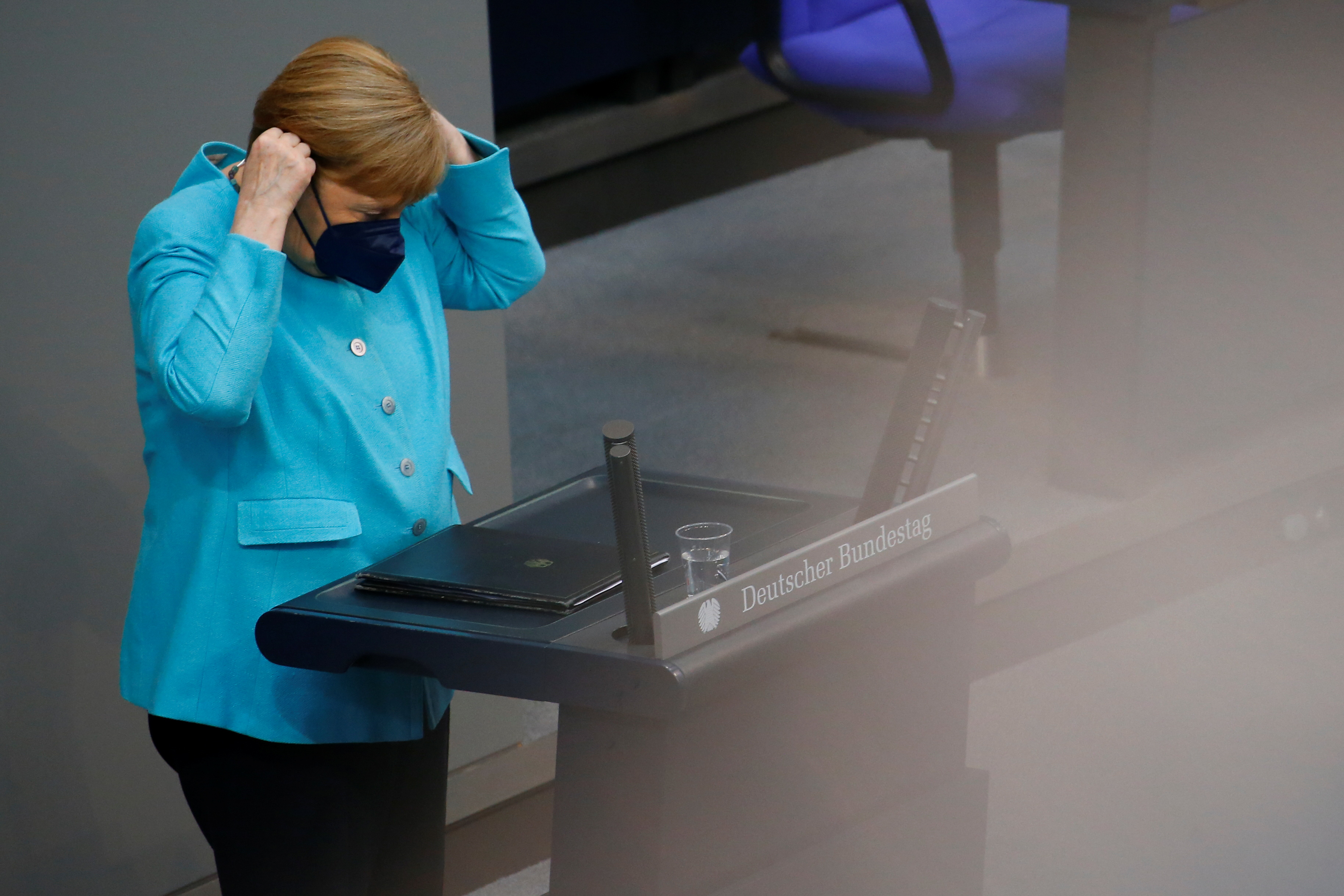 German Chancellor Angela Merkel wears her protective face mask after delivering a government declaration on the upcoming European Council meeting at the lower house of parliament Bundestag in Berlin, Germany, June 24, 2021. REUTERS/Michele Tantussi