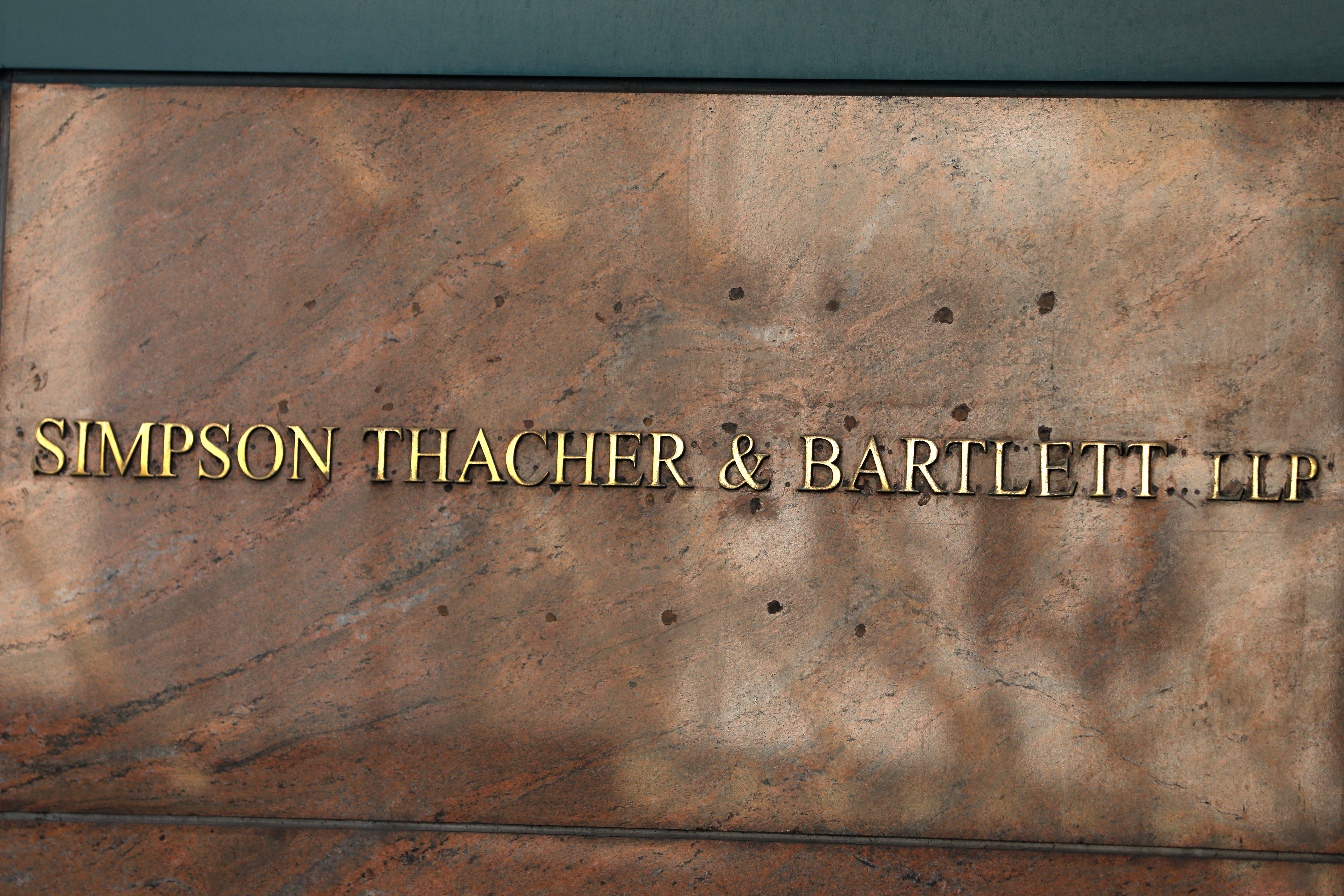 Signage is seen on the building exterior of the law firm Simpson Thacher & Bartlett LLP in Manhattan, New York City, U.S., August 17, 2020. REUTERS/Andrew Kelly