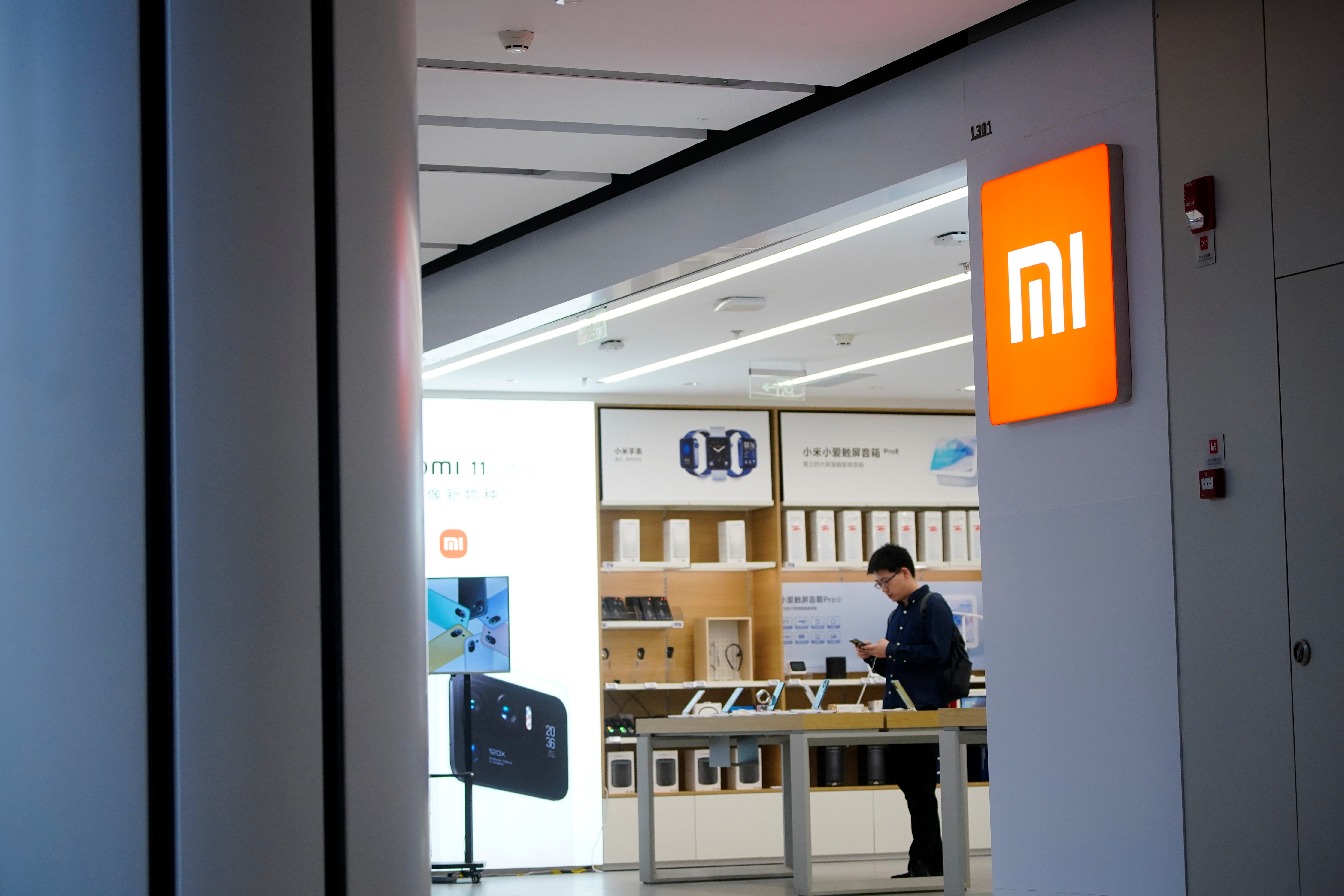 The Xiaomi logo is seen at a Xiaomi shop, in Shanghai, China May 12, 2021. REUTERS/Aly Song/File photo