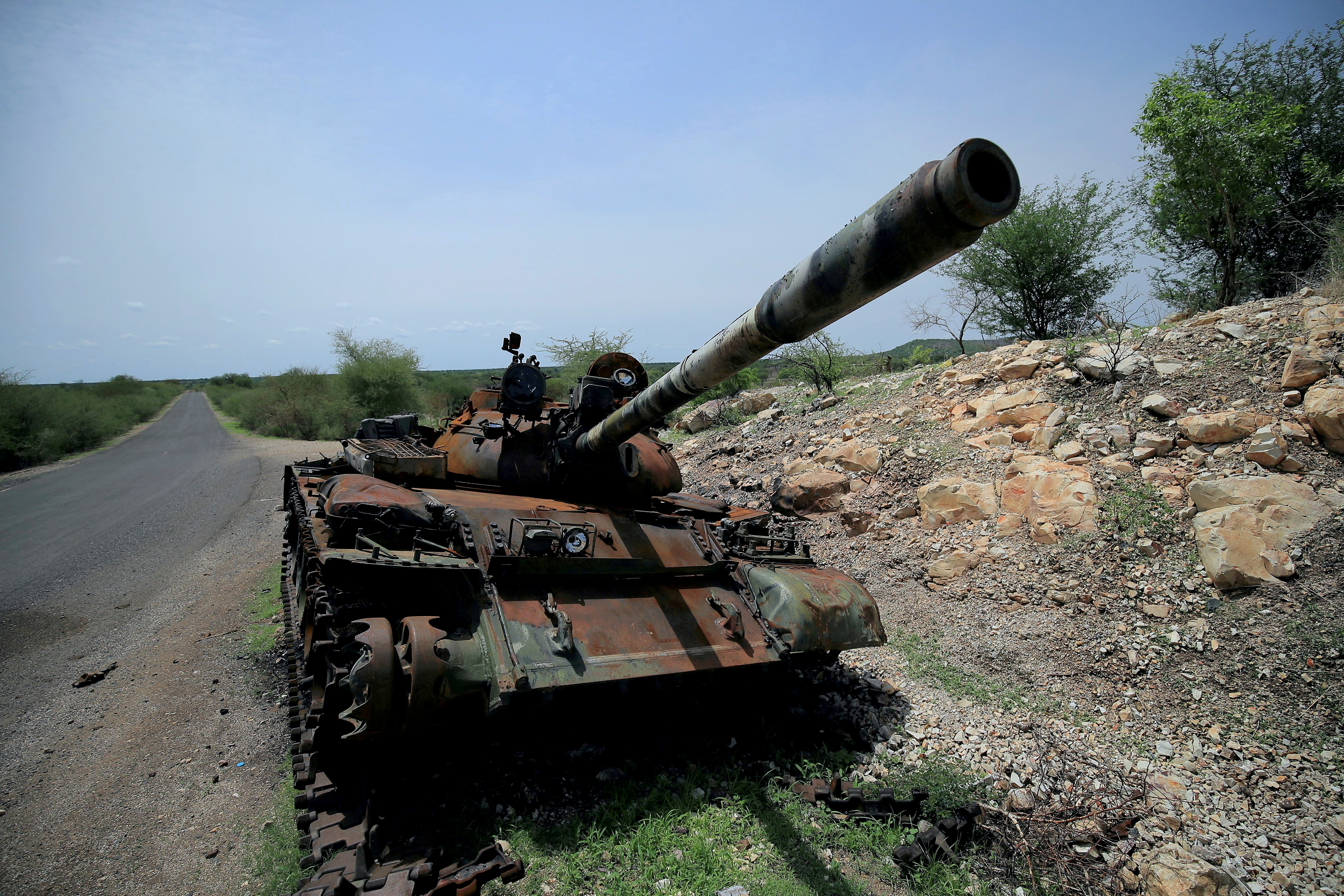 A tank damaged during the fighting between Ethiopia's National Defense Force (ENDF) and Tigray Special Forces stands on the outskirts of Humera town in Ethiopia, July 1, 2021.  REUTERS/Stringer/File Photo