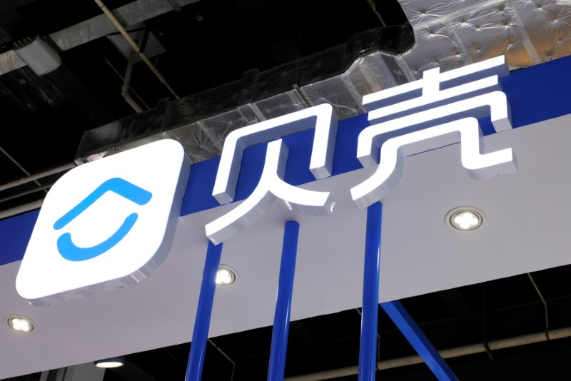 The logo of housing platform Beike, owned by KE Holdings, is seen at the World Artificial Intelligence Conference (WAIC) in Shanghai, China, July 8, 2021. REUTERS/Yilei Sun/File Photo