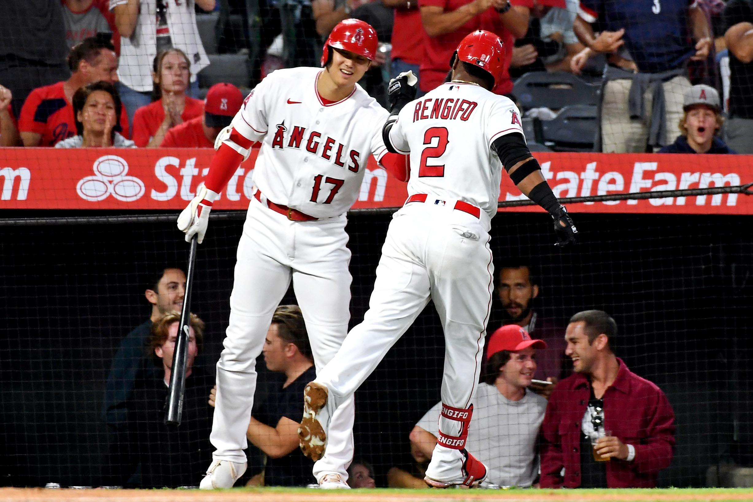 Jun 18, 2021; Anaheim, California, USA; Los Angeles Angels second baseman Luis Rengifo (2) celebrates with designated hitter Shohei Ohtani (17) after hitting a solo home run during the fifth inning against the Detroit Tigers at Angel Stadium. Mandatory Credit: Richard Mackson-USA TODAY Sports