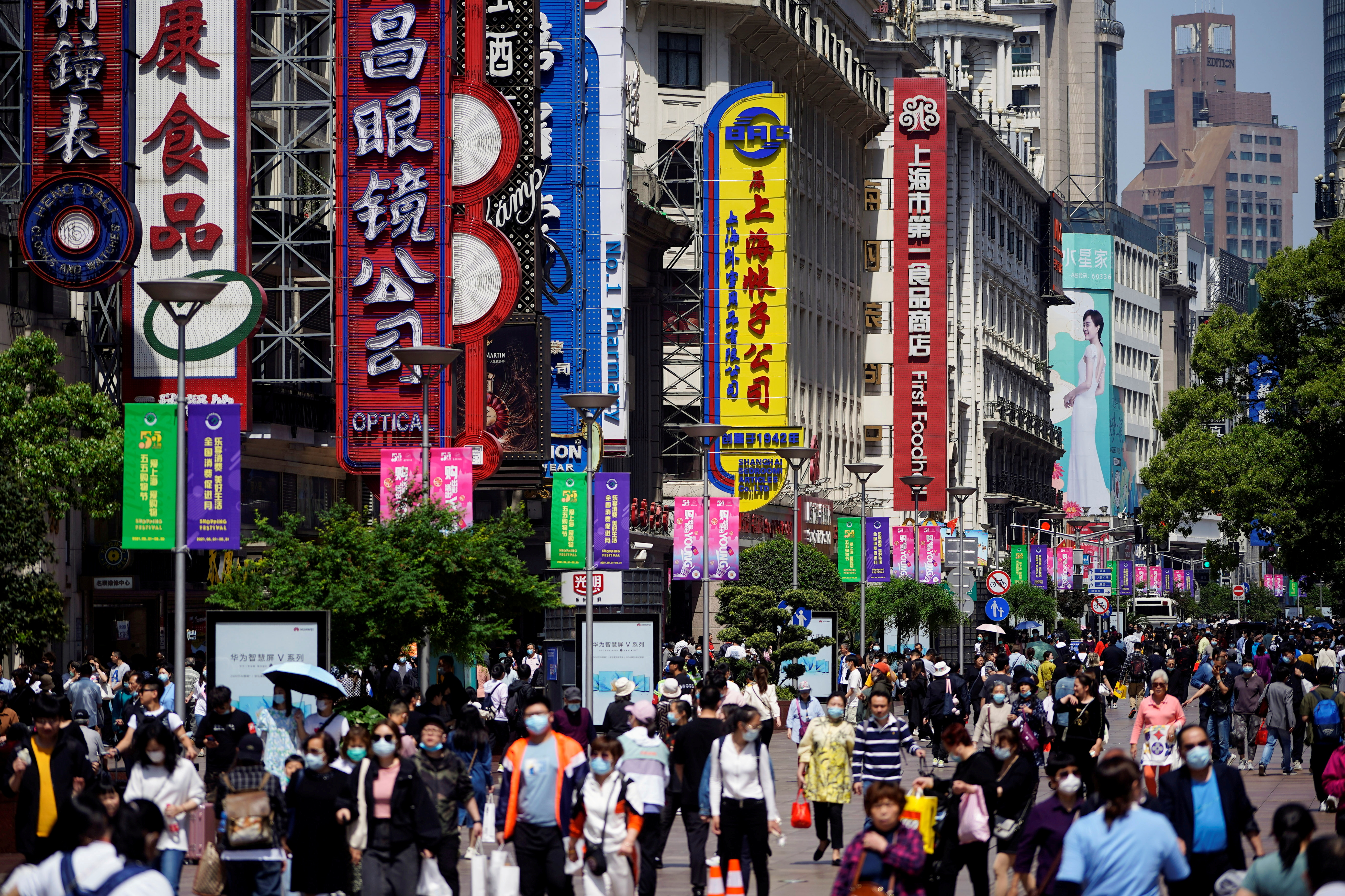 People walk along Nanjing Pedestrian Road, a main shopping area, in Shanghai, China May 5, 2021. REUTERS/Aly Song
