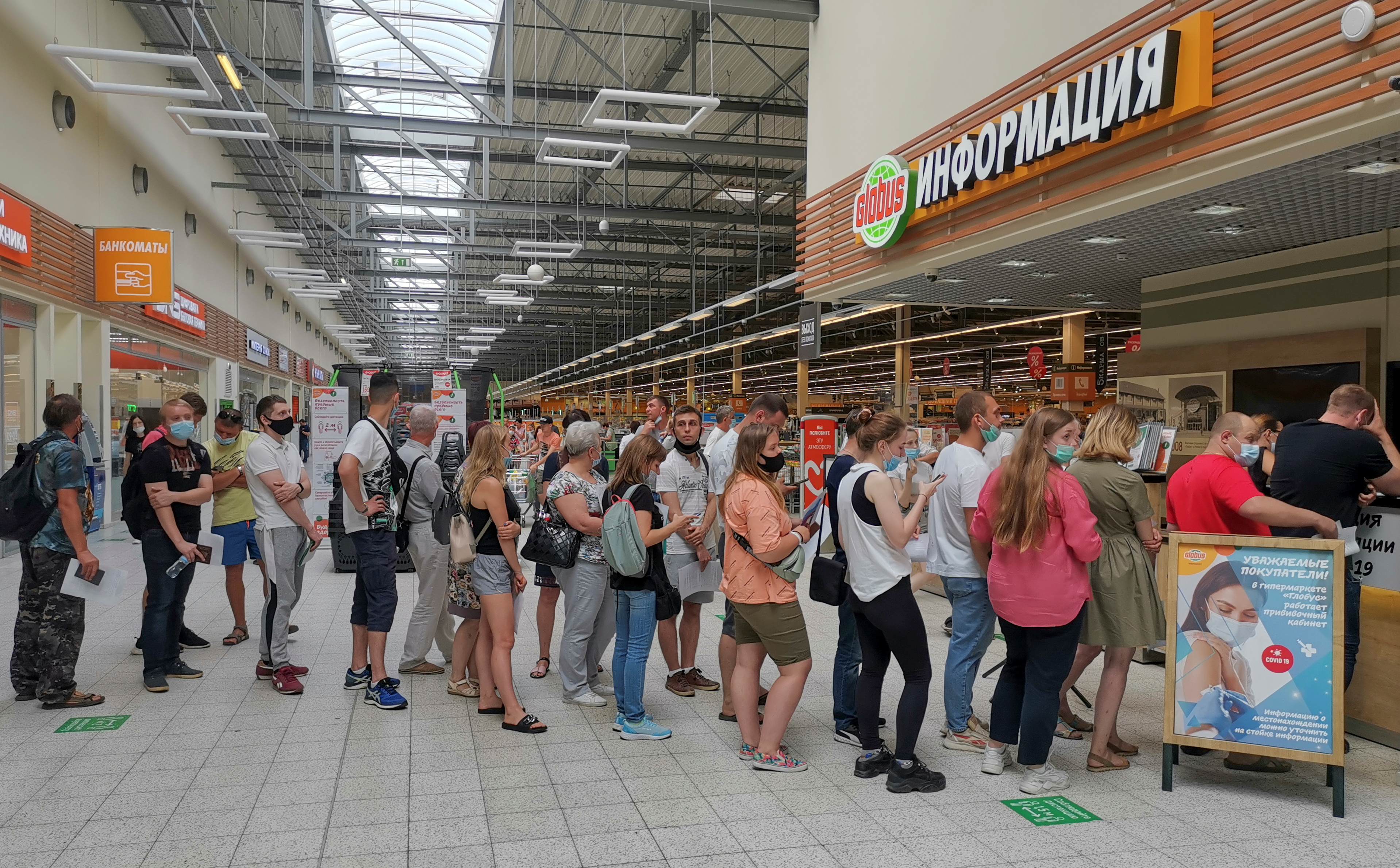 People line up to receive vaccine against the coronavirus disease (COVID-19) at a vaccination centre in the Globus shopping mall in Vladimir, Russia July 15, 2021. Picture taken July 15, 2021.  REUTERS/Polina Nikolskaya