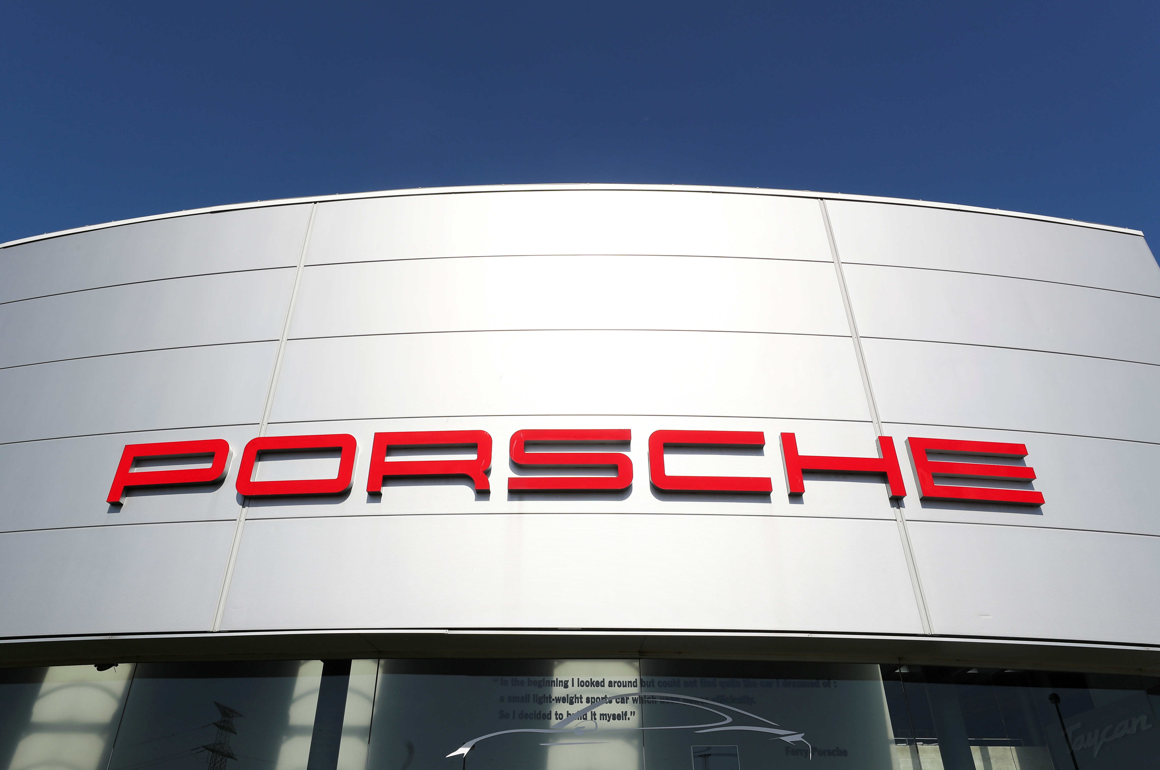 A logo of Porsche is seen outside a Porsche car dealer, amid the coronavirus disease (COVID-19) outbreak in Brussels, Belgium May 28, 2020. REUTERS/Yves Herman/File Photo