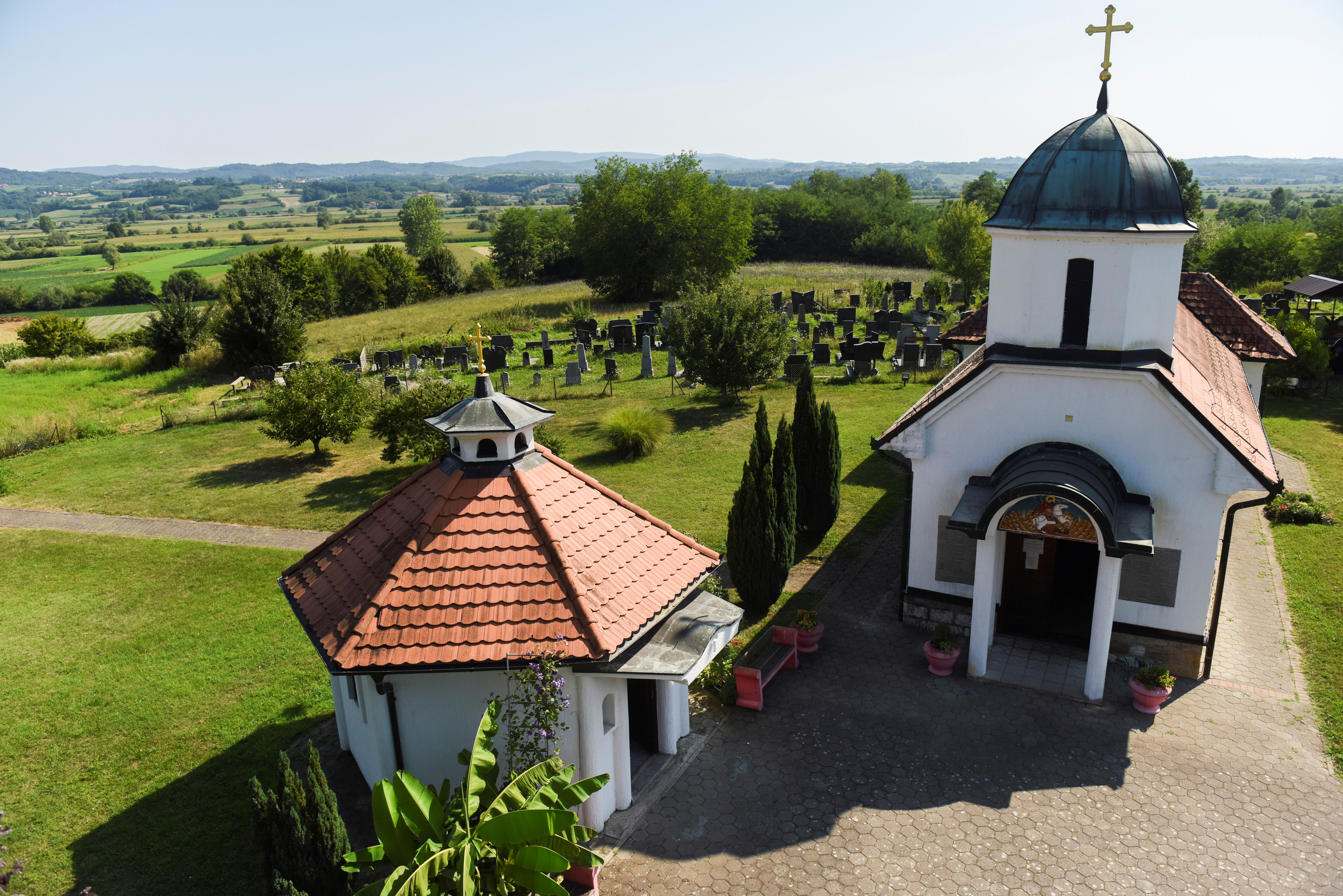A general view of the church of St. George in Gornje Nedeljice village, where the company Rio Tinto plans to build an underground mine for the exploitation of jadarite, in Serbia, August 9, 2021. Picture taken August 9, 2021. REUTERS/Zorana Jevtic