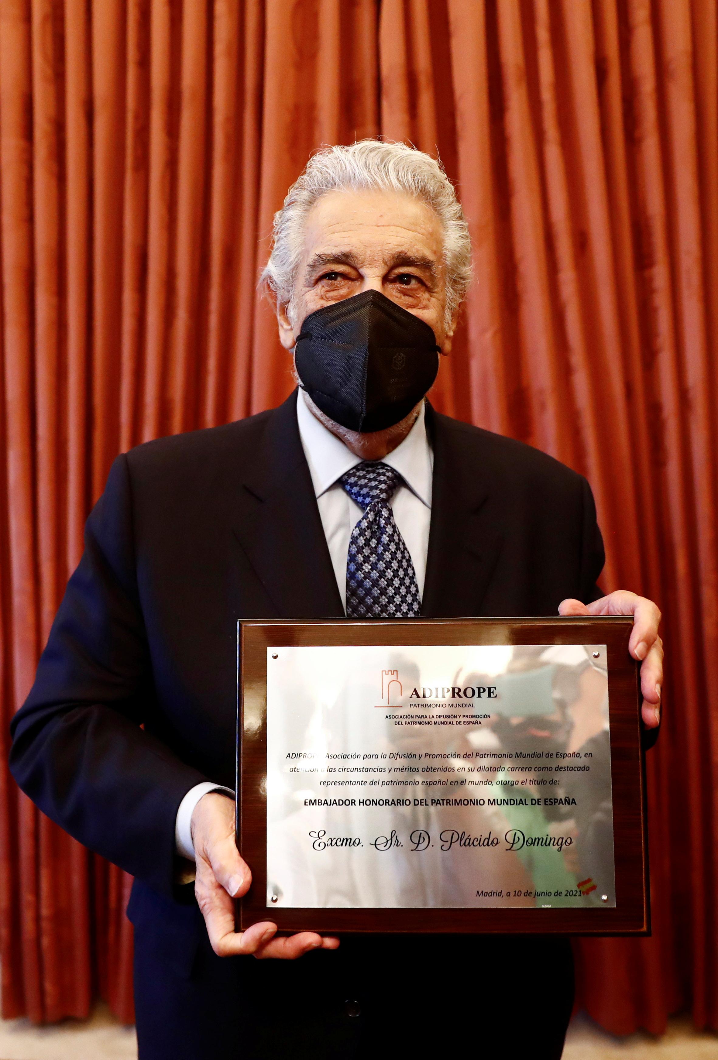 Spanish tenor Placido Domingo receives the