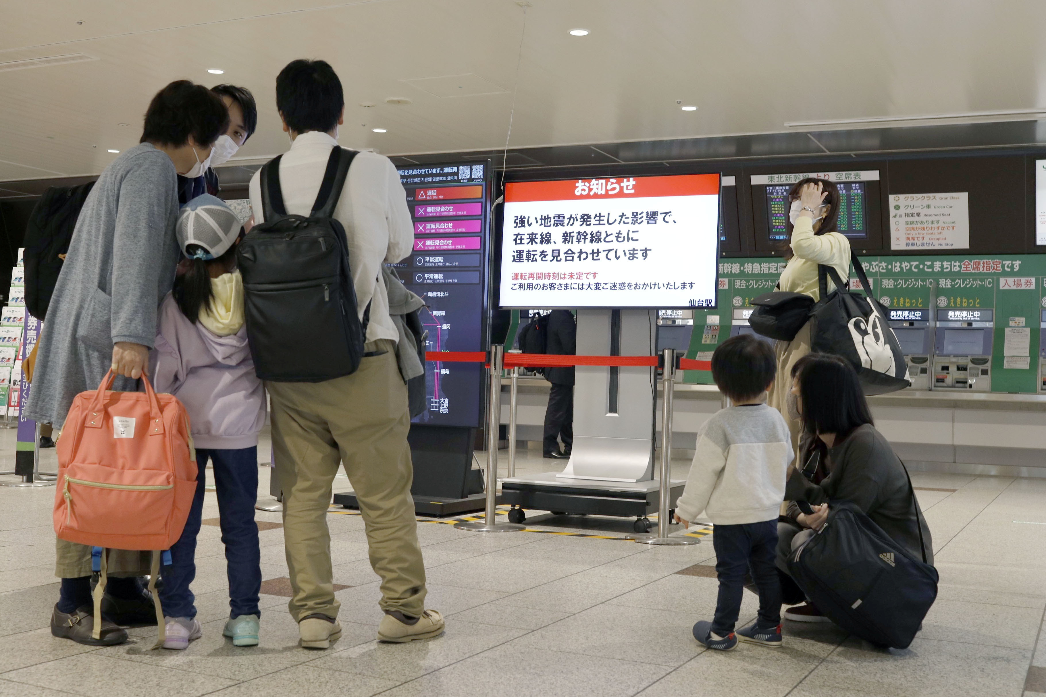 People gather around a ticket gate as train services are suspended following an earthquake in Sendai, Miyagi prefecture, Japan in this photo taken by Kyodo on May 1, 2021.  Mandatory credit Kyodo/via REUTERS