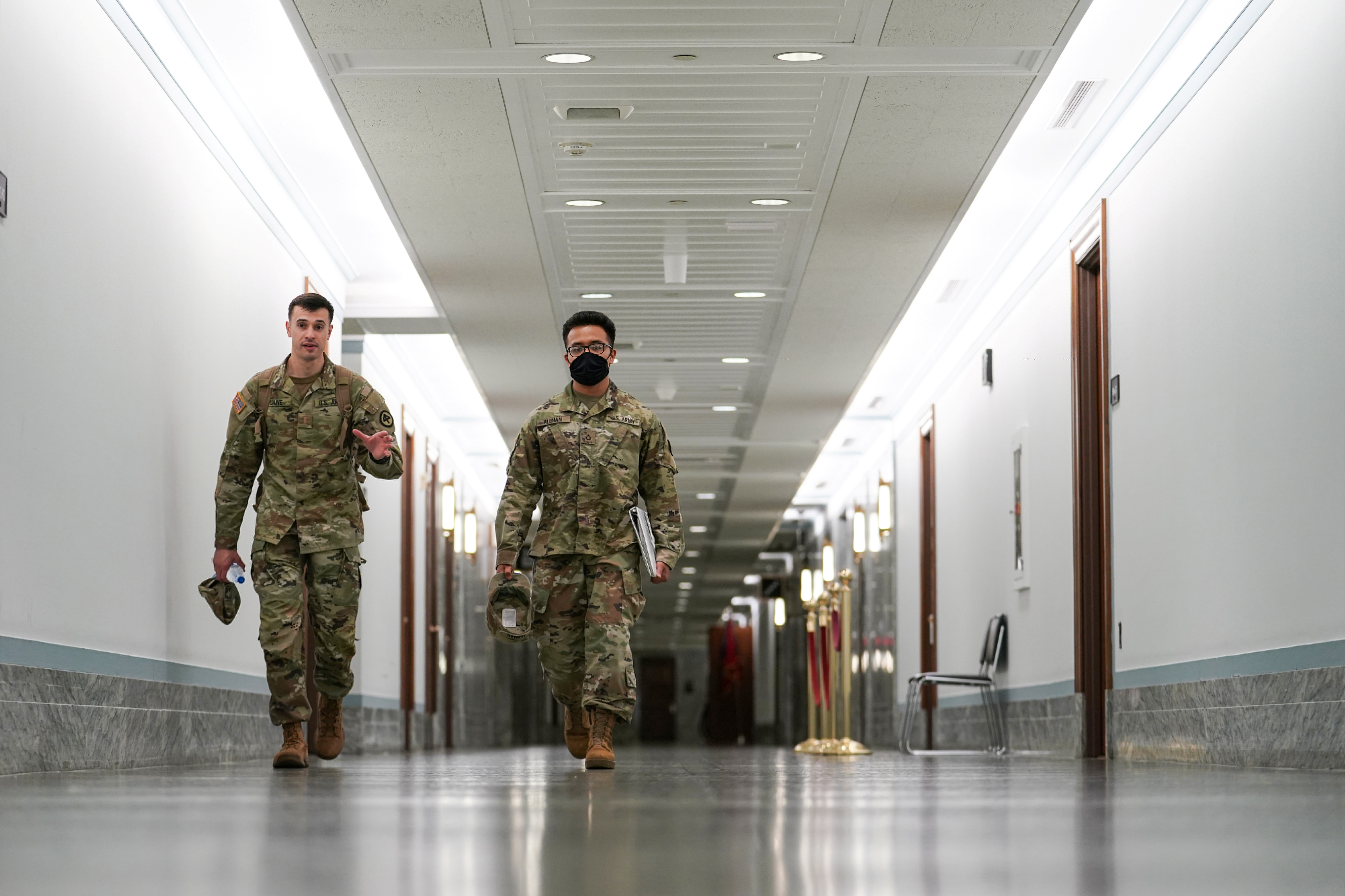 Members of the National Guard walk in the Dirksen Senate Office Building on Capitol Hill on the final days of their deployment following the January 6 Capitol riots in Washington, U.S., May 23, 2021. REUTERS/Sarah Silbiger
