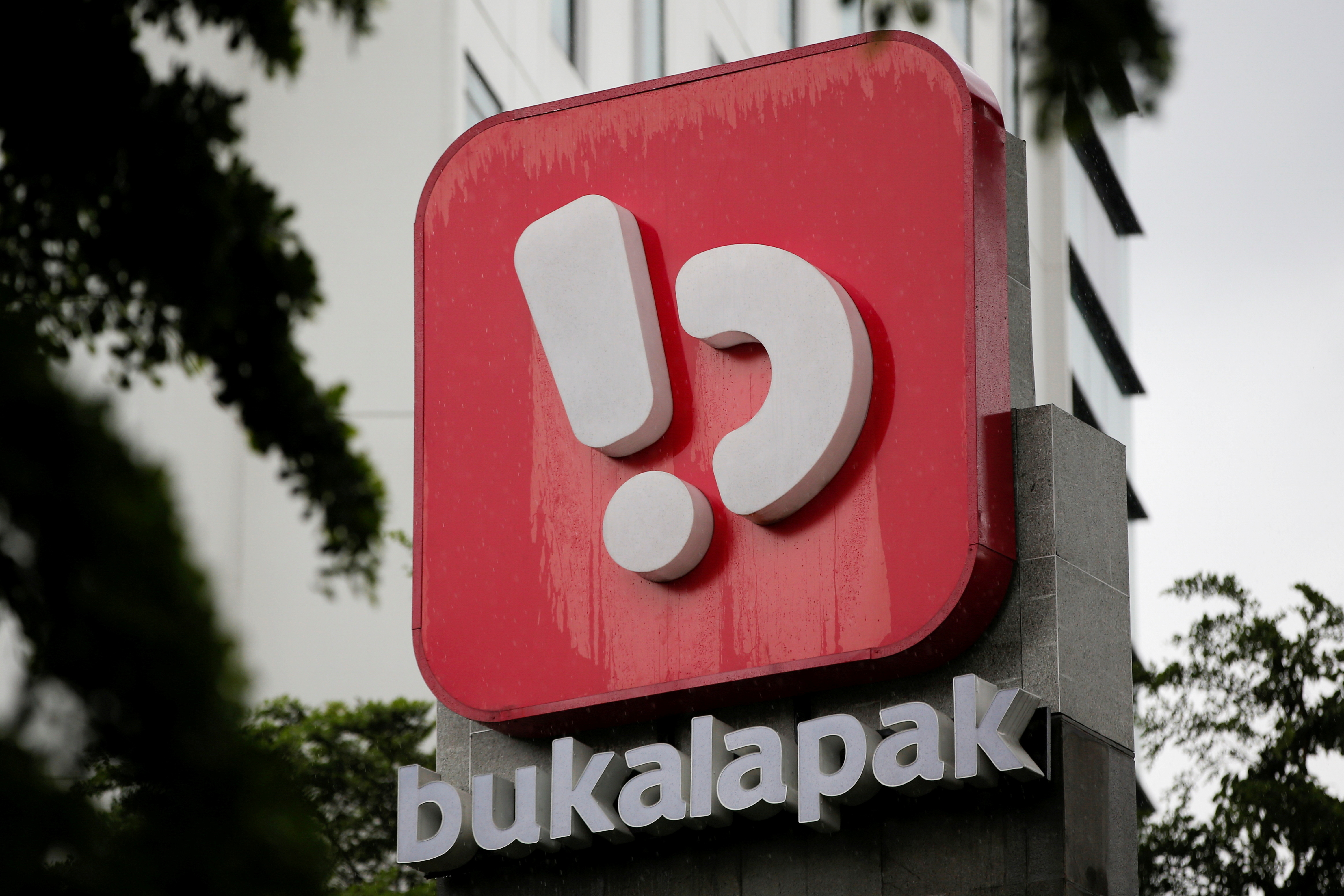 Logo of Bukalapak, an Indonesian e-commerce firm, is seen outside its headquarters in Jakarta, Indonesia, June 16, 2021. REUTERS/Willy Kurniawan