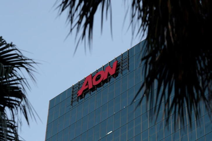 An office building with the Aon logo is seen amid the easing of the coronavirus disease (COVID-19) restrictions in the Central Business District of Sydney, Australia, June 3, 2020. REUTERS/Loren Elliott/File Photo