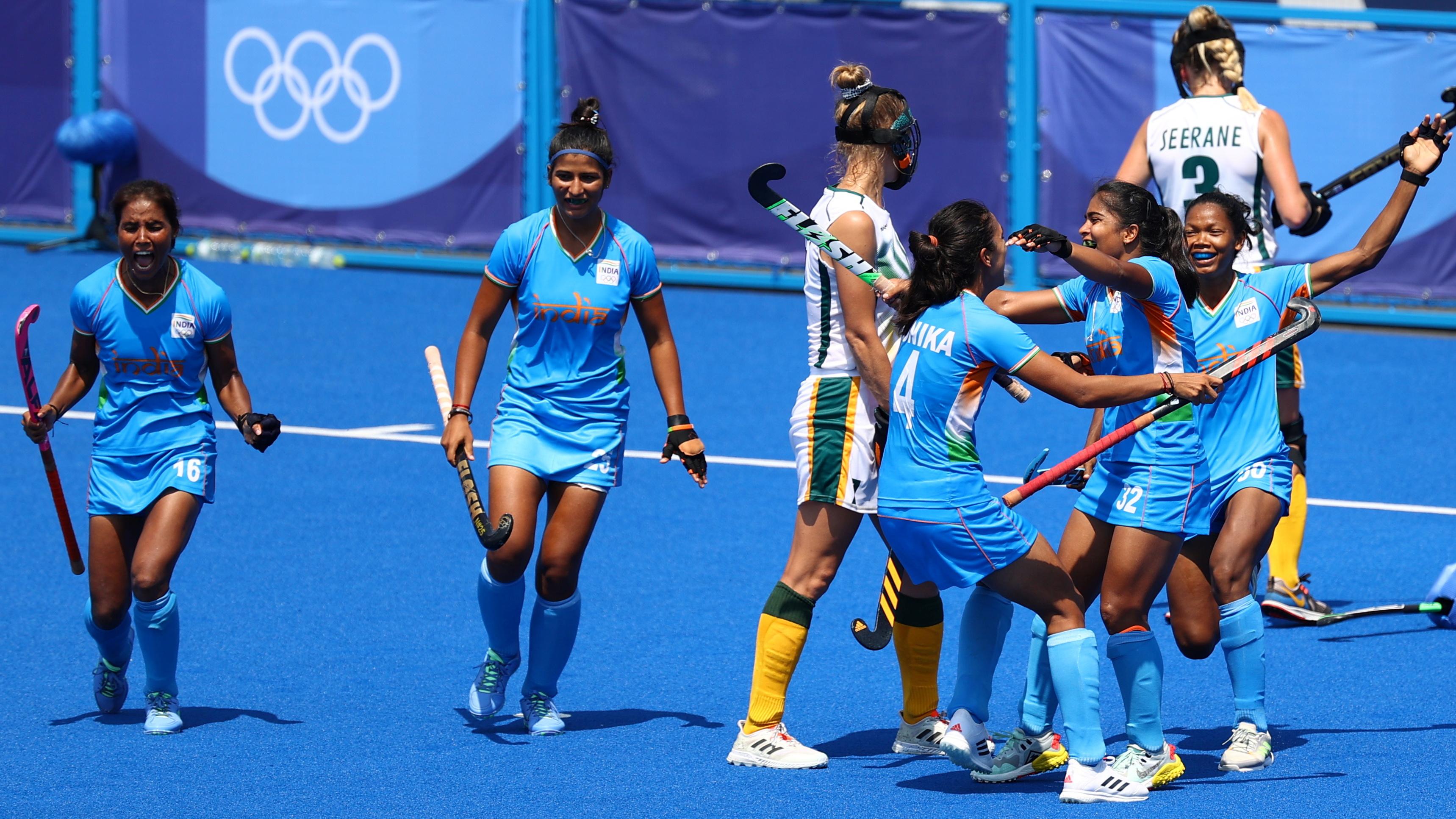 Tokyo 2020 Olympics - Hockey - Women's Pool A - India v South Africa - Oi Hockey Stadium, Tokyo, Japan - July 31, 2021. Neha Goyal of India celebrates with teammates after scoring. REUTERS/Corinna Kern