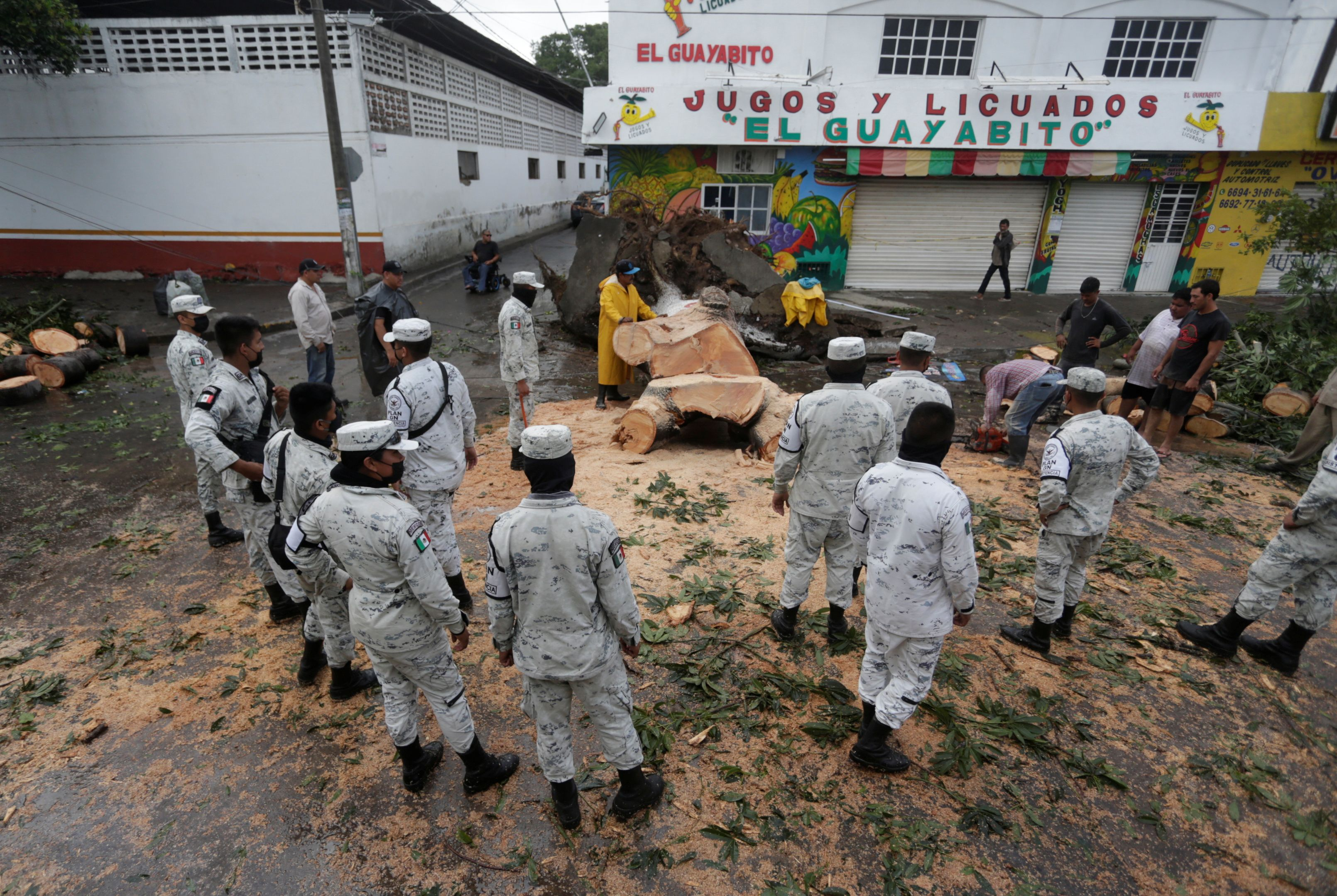 Members of the National Guard gather as hurricane Pamela pounds the Pacific coast resort with strong winds as it makes landfall in Mazatlan, Mexico October 13, 2021. REUTERS/Daniel Becerril