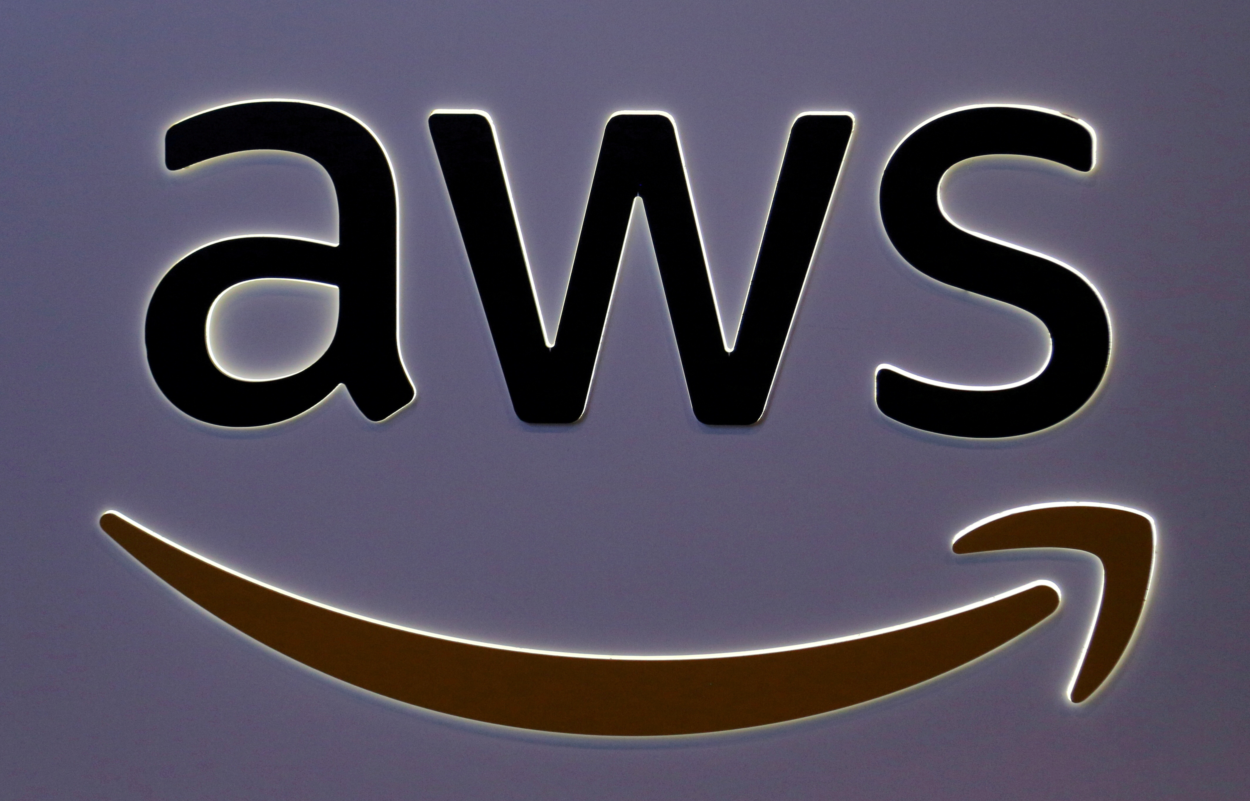 FILE PHOTO: The logo for Amazon Web Services (AWS) is seen at the SIBOS banking and financial conference in Toronto, Ontario, Canada October 19, 2017. REUTERS/Chris Helgren/File Photo