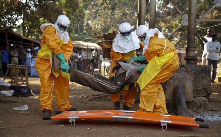 A French Red Cross team picks up a suspected Ebola case from the centre of Forecariah on January 30, 2015. REUTERS/Misha Hussain