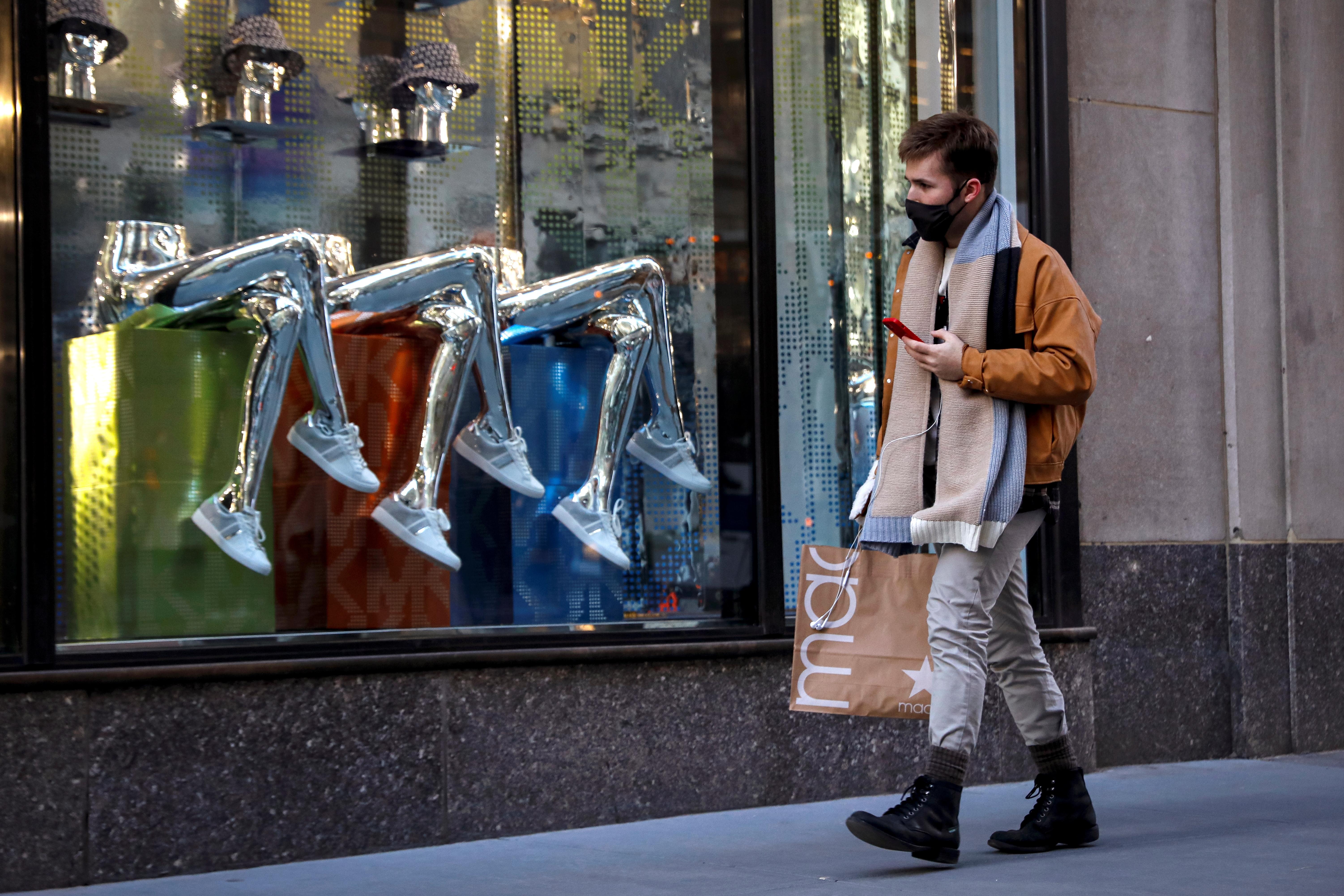 A man shops, during the coronavirus disease (COVID-19) pandemic, on 5th Avenue in New York, U.S., February 17, 2021.  REUTERS/Brendan McDermid