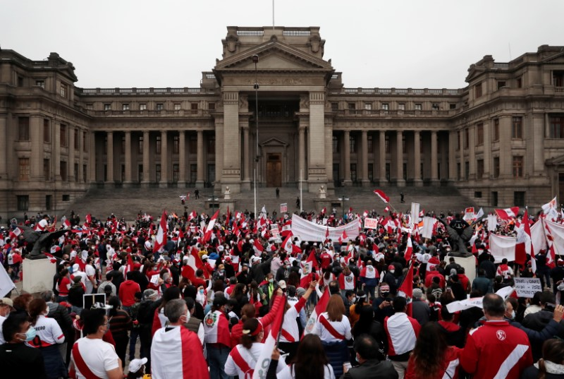 Supporters of Peru's presidential candidate Keiko Fujimori gather outside the Palace of Justice, the seat of Peru's Supreme Court, during a demonstration in Lima, Peru June 12, 2021.  REUTERS/Alessandro Cinque