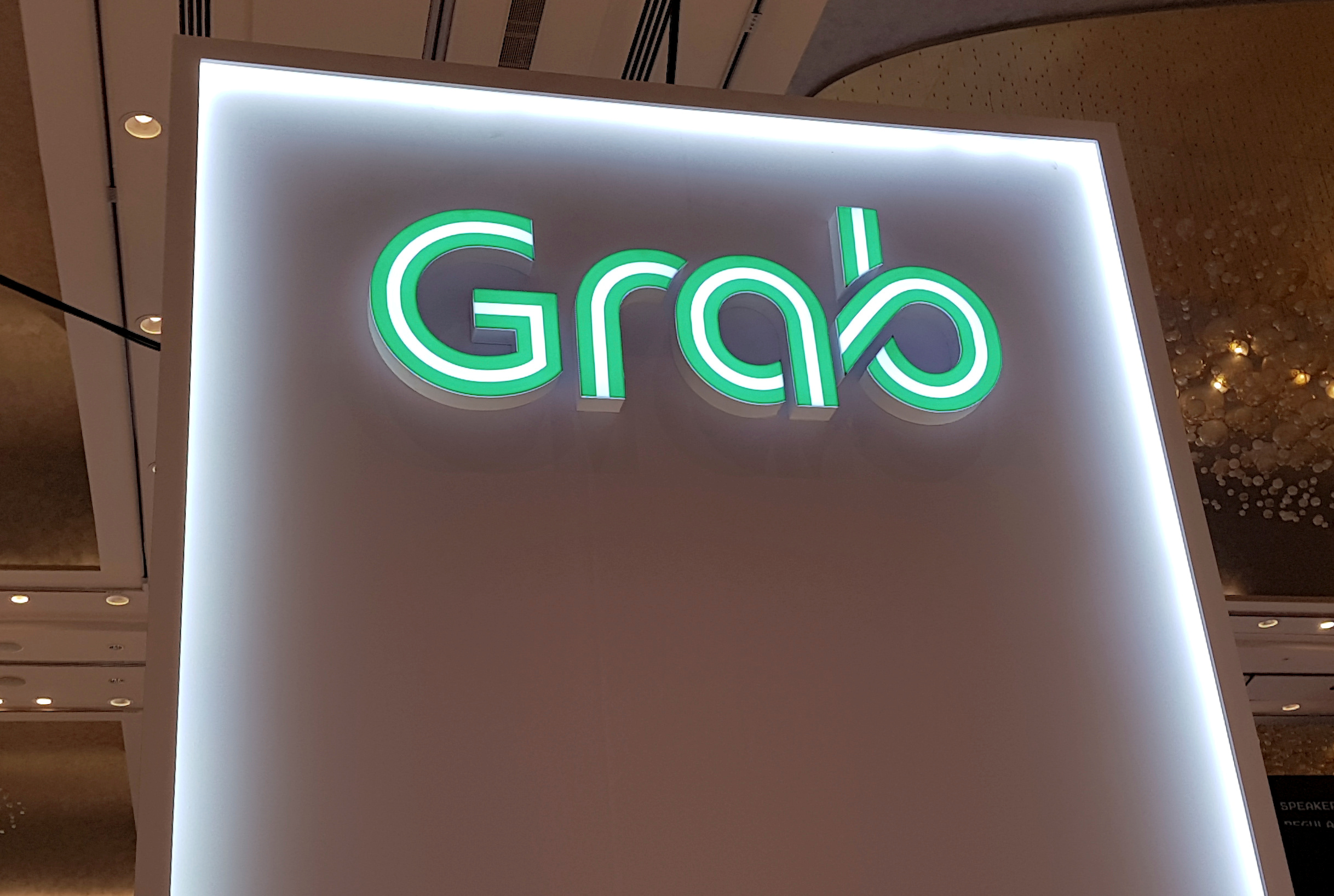 A Grab logo is pictured at the Money 20/20 Asia Fintech Trade Show in Singapore March 21, 2019. Picture taken March 21, 2019. REUTERS/Anshuman Daga/File Photo