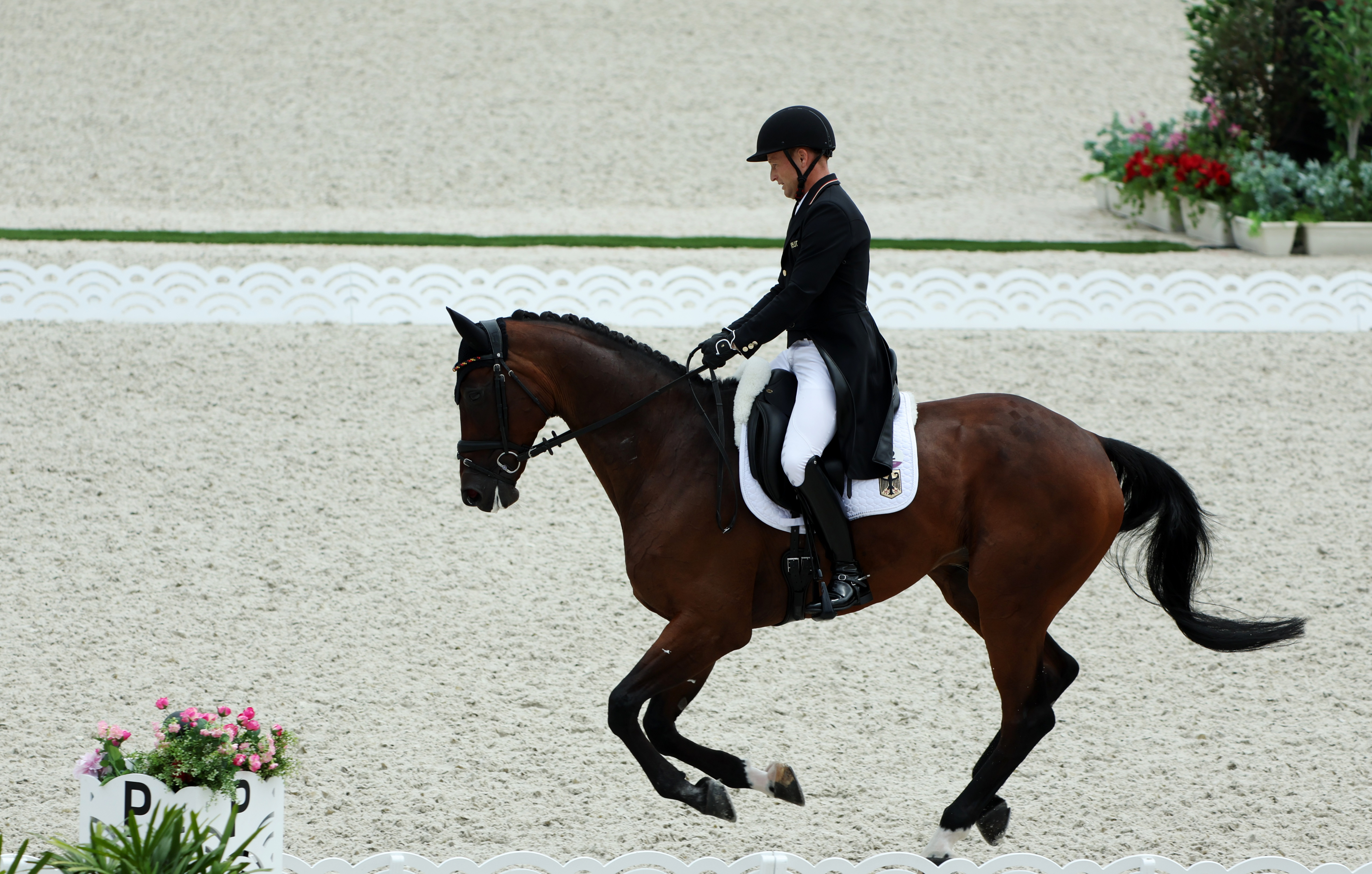 Tokyo 2020 Olympics - Equestrian - Eventing - Dressage Individual - Day 2 - Equestrian Park - Tokyo, Japan - July 31, 2021.  Michael Jung of Germany on his horse Chipmunk Frh compete REUTERS/Alkis Konstantinidis