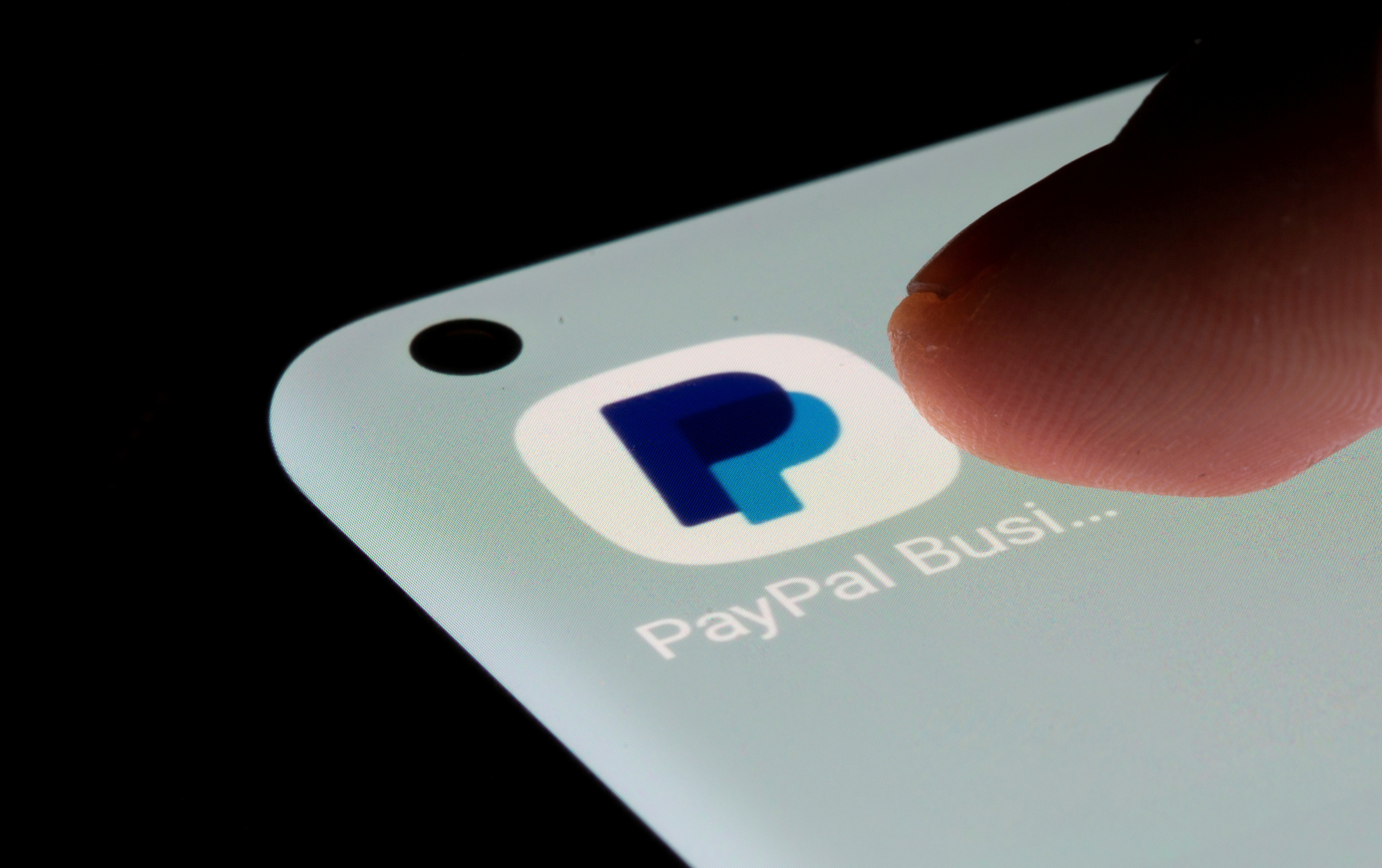 PayPal app is seen on a smartphone in this illustration taken, July 13, 2021. REUTERS/Dado Ruvic/Illustration/File Photo