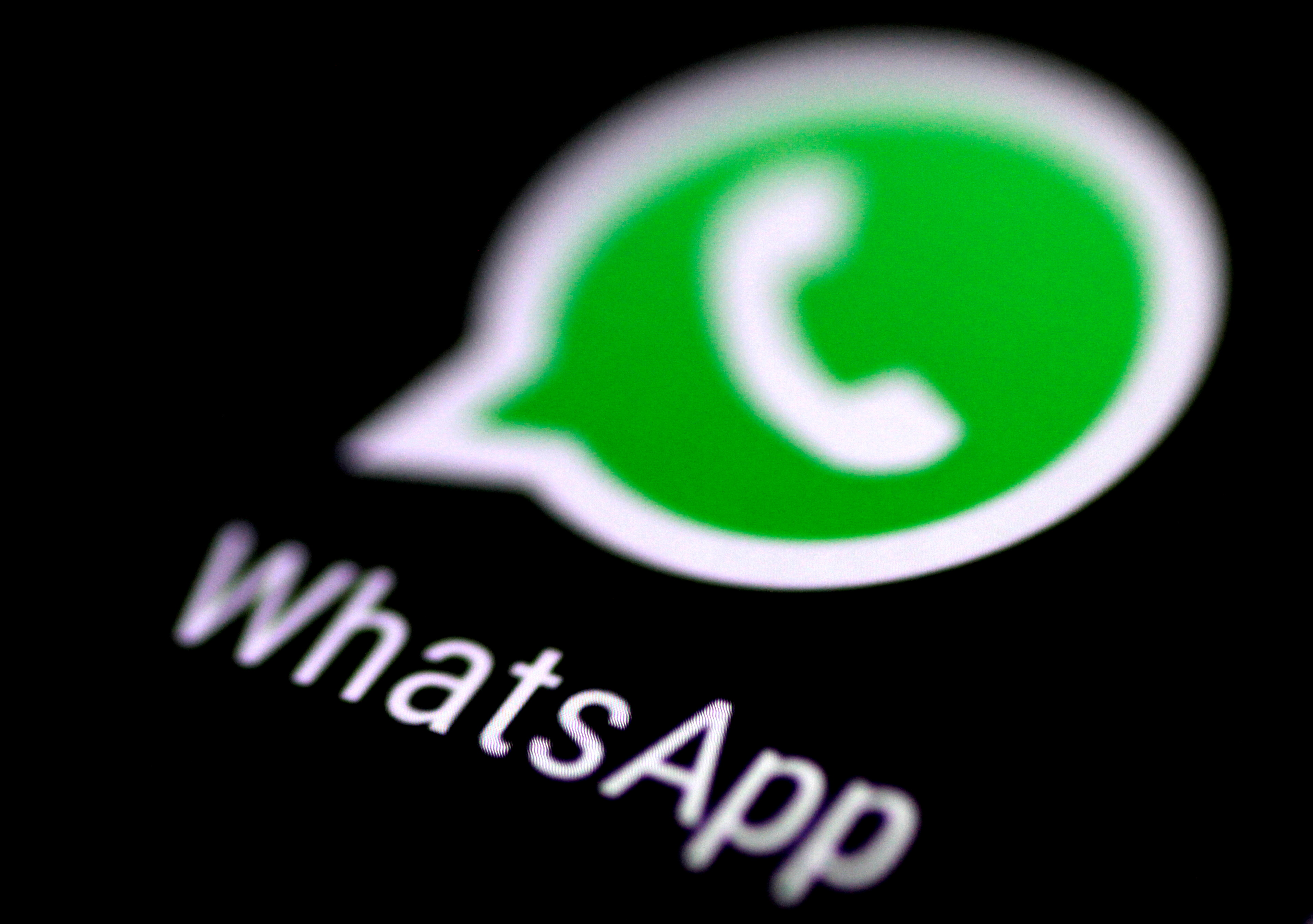The WhatsApp messaging application is seen on a phone screen August 3, 2017.   REUTERS/Thomas White//File Photo