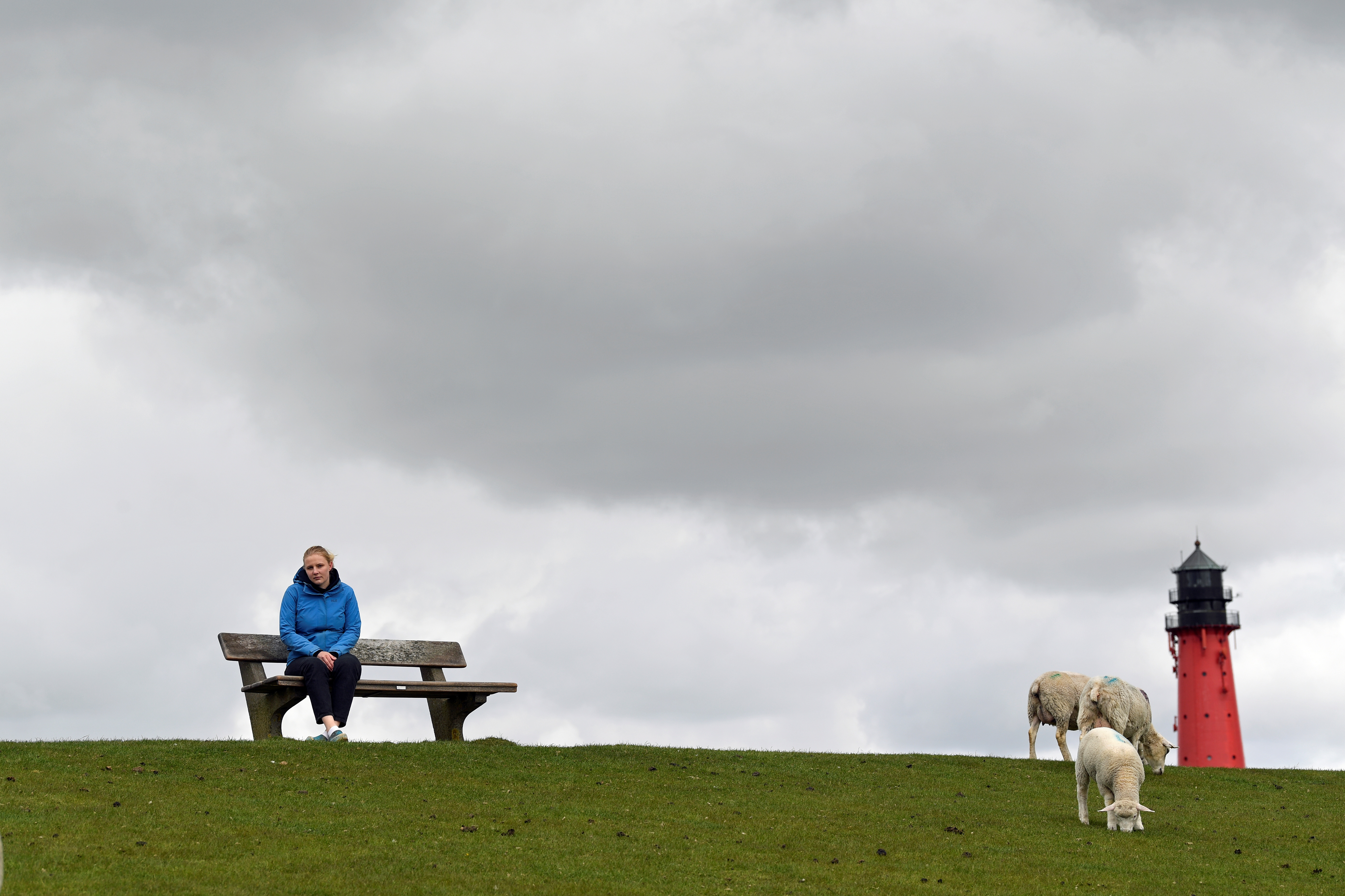 Sophie Backsen, 22, daughter of a farming family, which forced Germany by court to tighten its climate law, sits on a dyke on the North Sea island of Pellworm, Germany May 3, 2021. Picture taken May 3, 2021. REUTERS/Fabian Bimmer