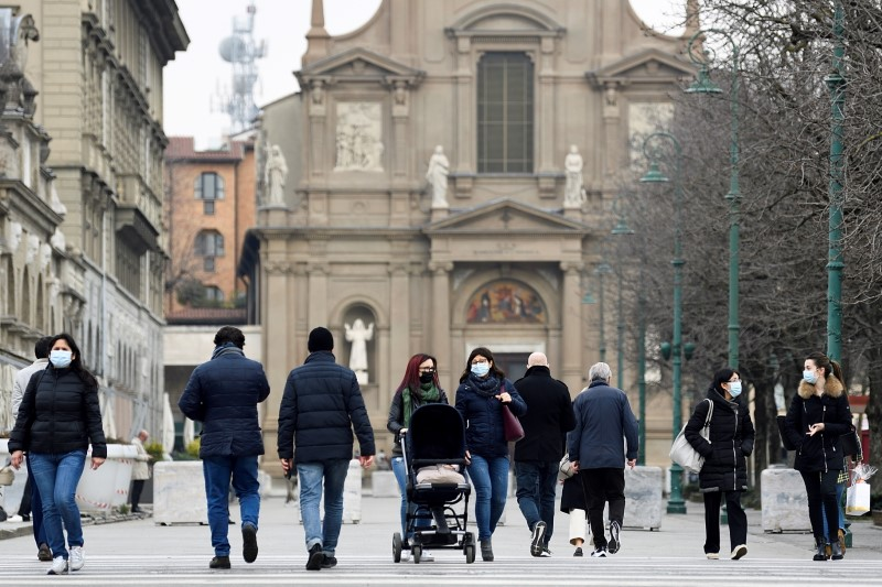 People walk at a street a year after the peak of Italy's coronavirus disease (COVID-19) outbreak, in Bergamo, the country's epicentre, Italy, March 3, 2021. REUTERS/Flavio Lo Scalzo/File Photo