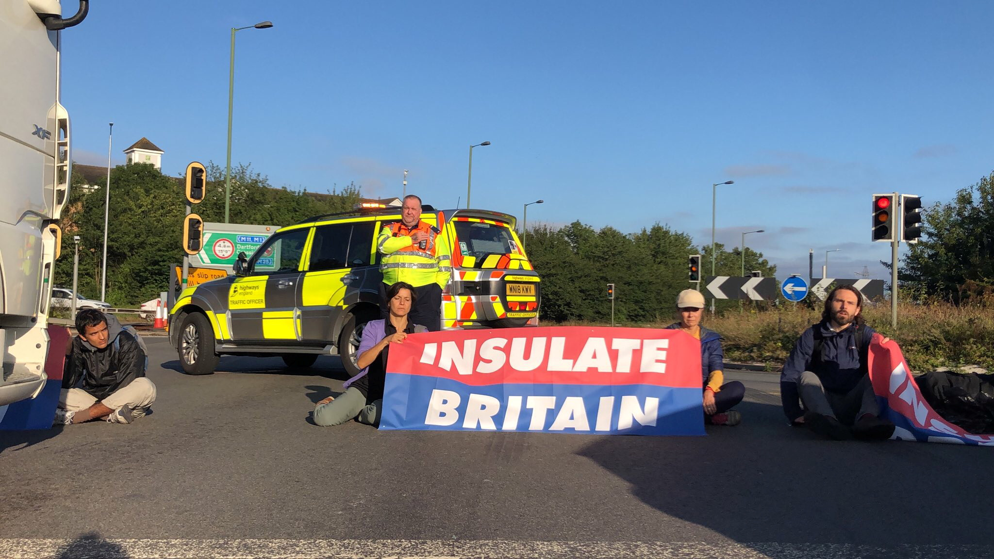 Members of Insulate Britain protest on M25 Motorway, Britain September 15, 2021. Insulate Britain/Handout via REUTERS    THIS IMAGE HAS BEEN SUPPLIED BY A THIRD PARTY. NO RESALES. NO ARCHIVES. MANDATORY CREDIT