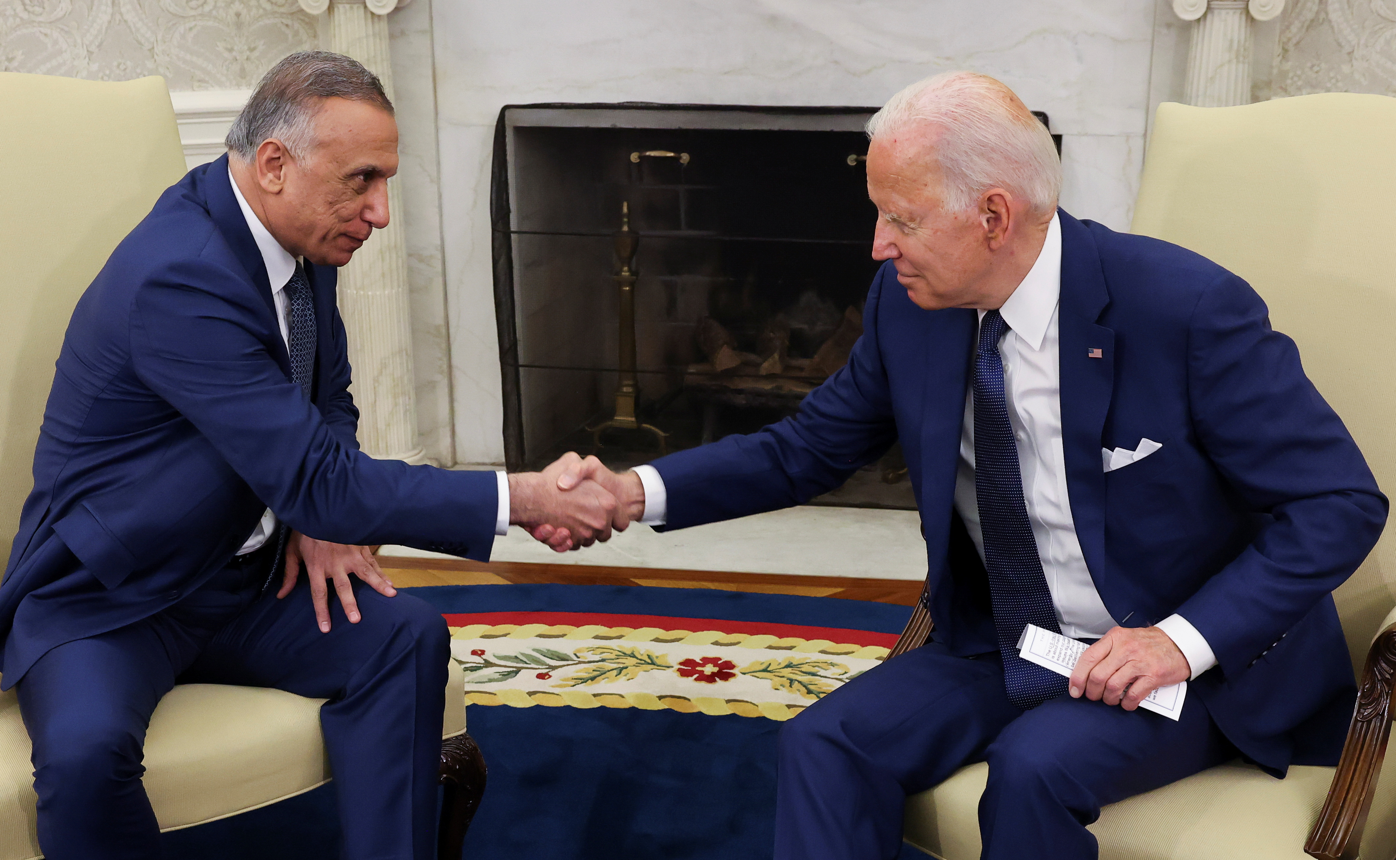 U.S. President Joe Biden greets Iraq's Prime Minister Mustafa Al-Kadhimi during a bilateral meeting in the Oval Office at the White House in Washington, U.S., July 26, 2021. REUTERS/Evelyn Hockstein