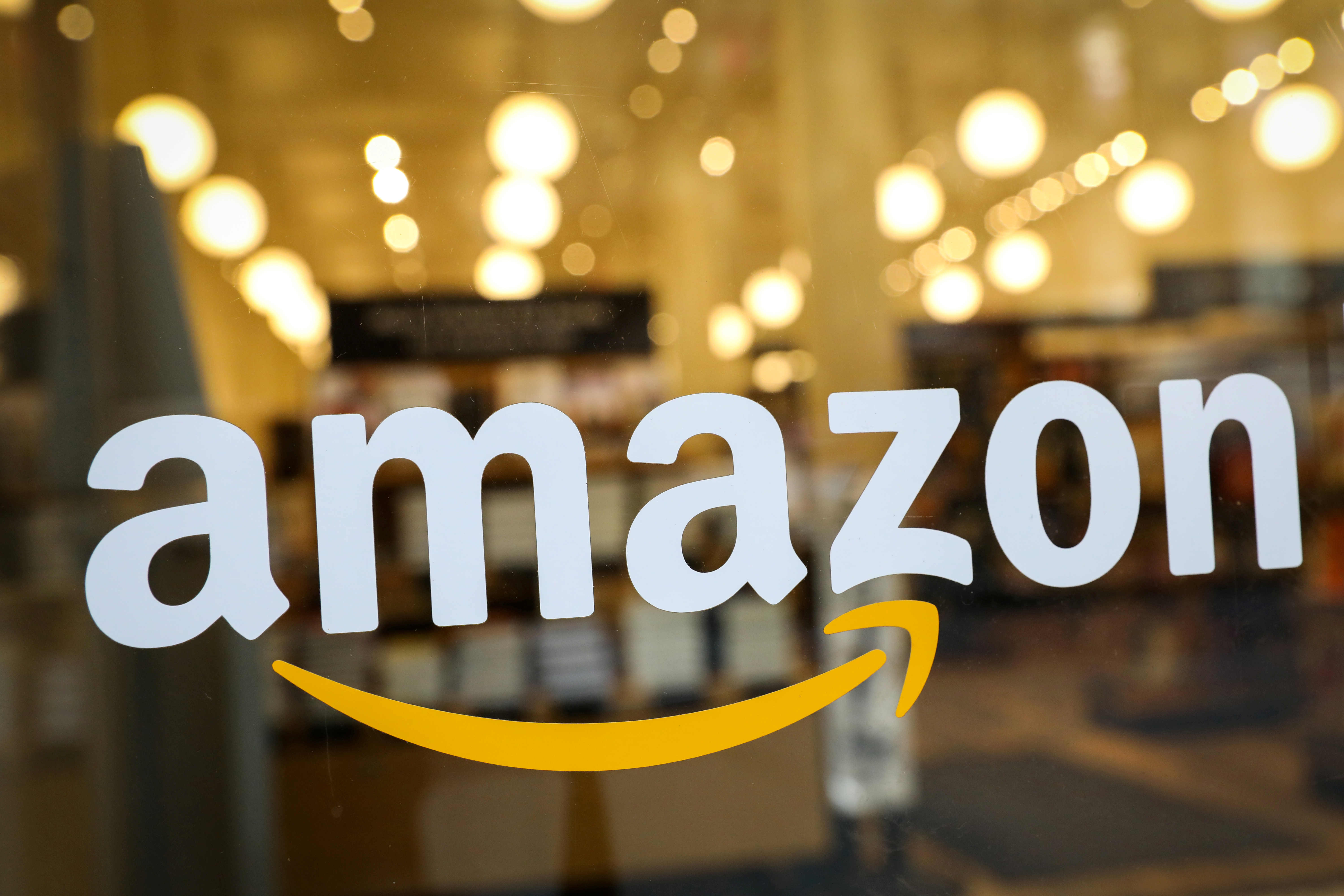 The logo of Amazon is seen on the door of an Amazon Books retail store in New York City, U.S., February 14, 2019. REUTERS/Brendan McDermid/File Photo