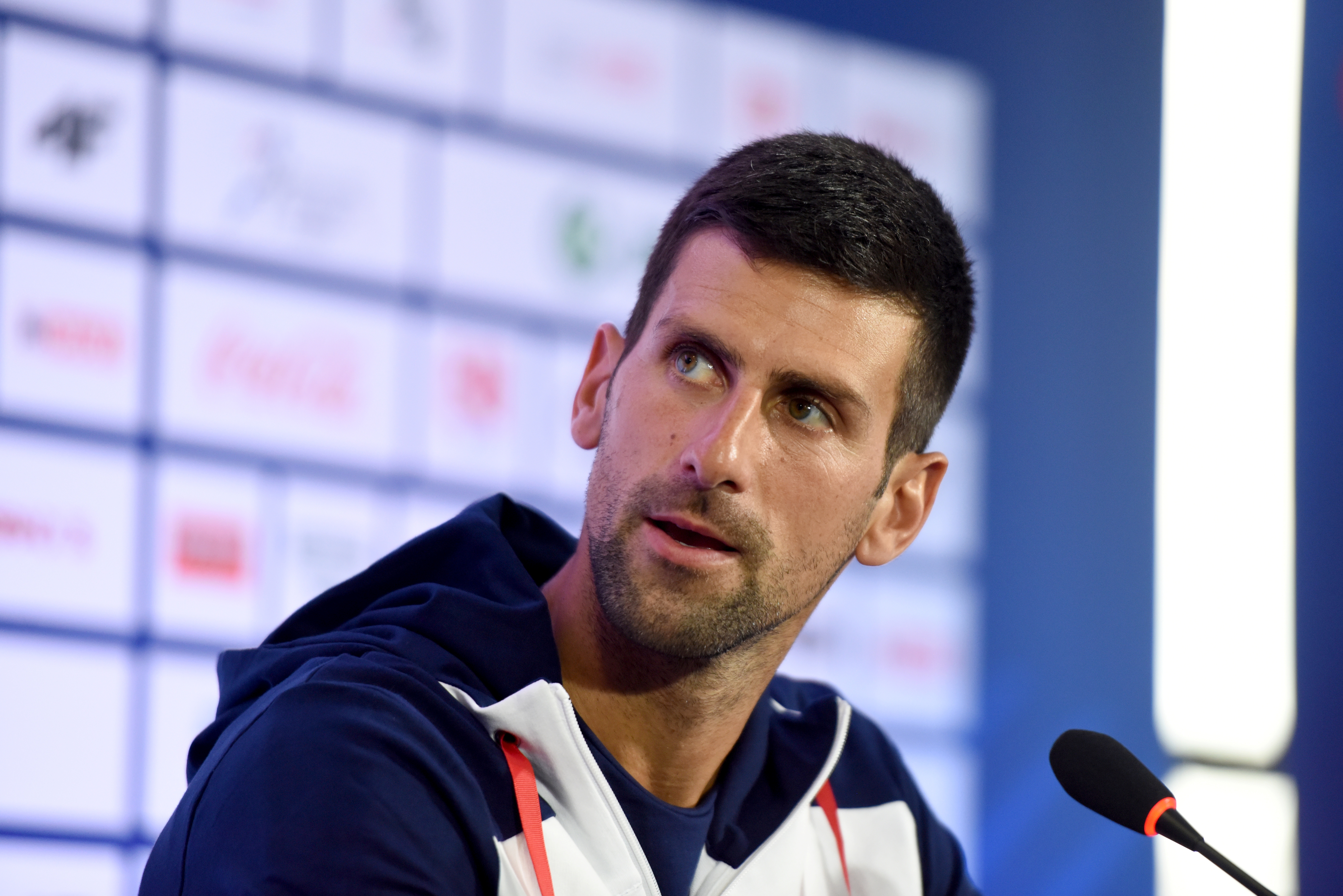 Tennis player Novak Djokovic speaks to the media before traveling to Japan where he will represent Serbia at the Tokyo 2020 Olympics, in Belgrade, Serbia, July 20, 2021. REUTERS/Zorana Jevtic