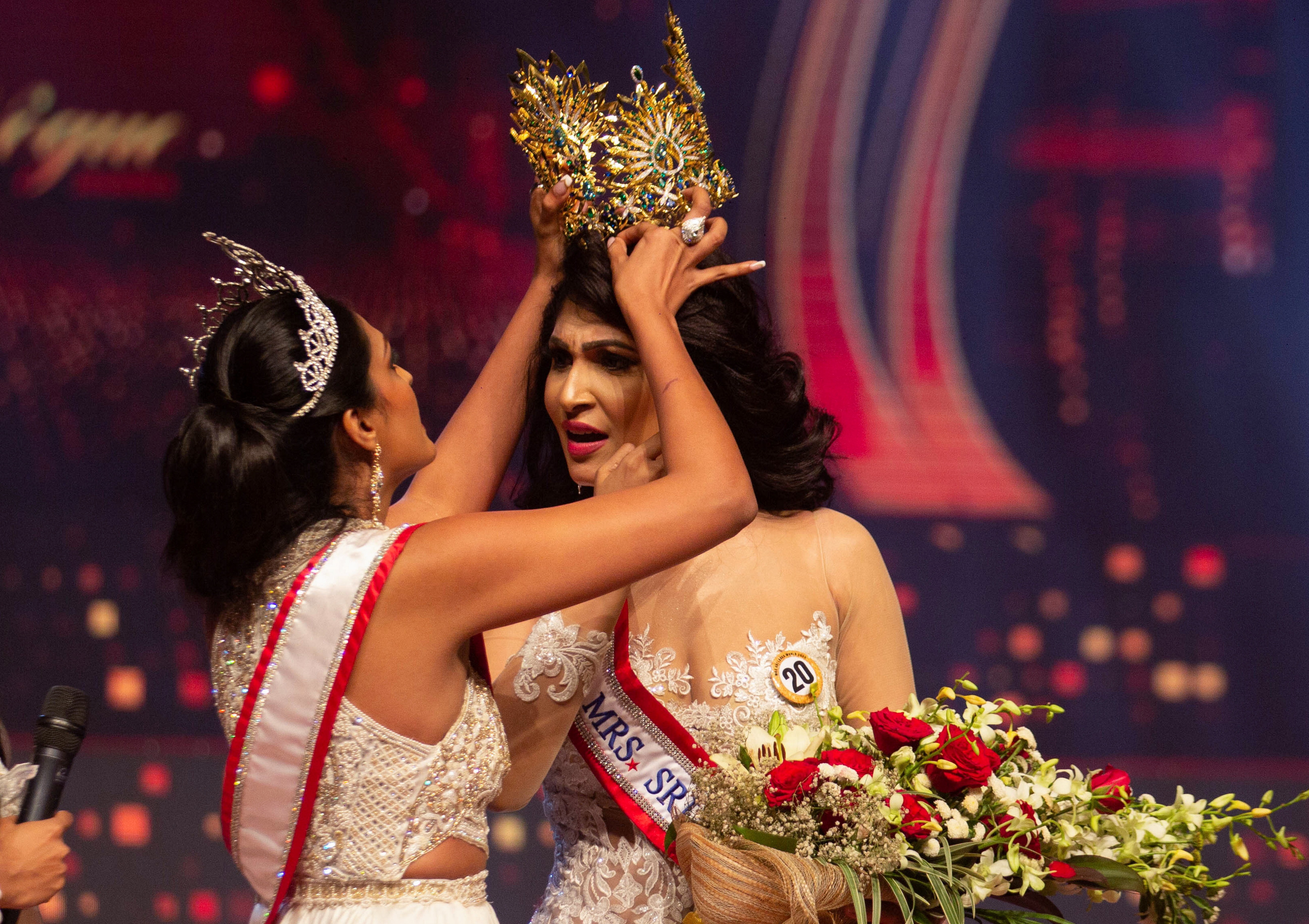 Reigning Mrs World Caroline Jurie, forcibly removes the Mrs Sri Lanka winner Pushpika De Silva's crown as Jurie declared that the winner was ineligible because she was divorced, during the Mrs Sri Lanka pageant, in Colombo, Sri Lanka April 4, 2021. REUTERS/Gimhana Pathirana