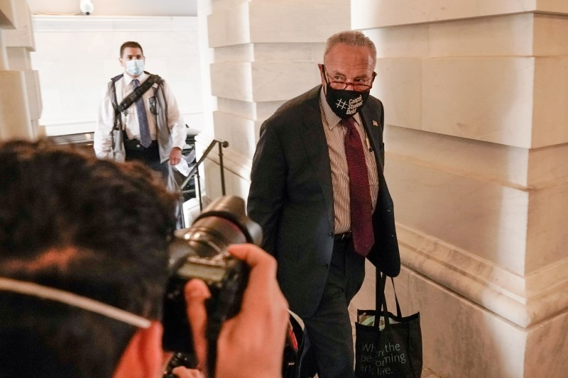 Senate Majority Leader Chuck Schumer, (D-NY), enters the U.S. Capitol as republican and democratic leaders continue to work on an amendment to the bipartisan infrastructure bill in Washington, U.S., August 7, 2021. REUTERS/Ken Cedeno
