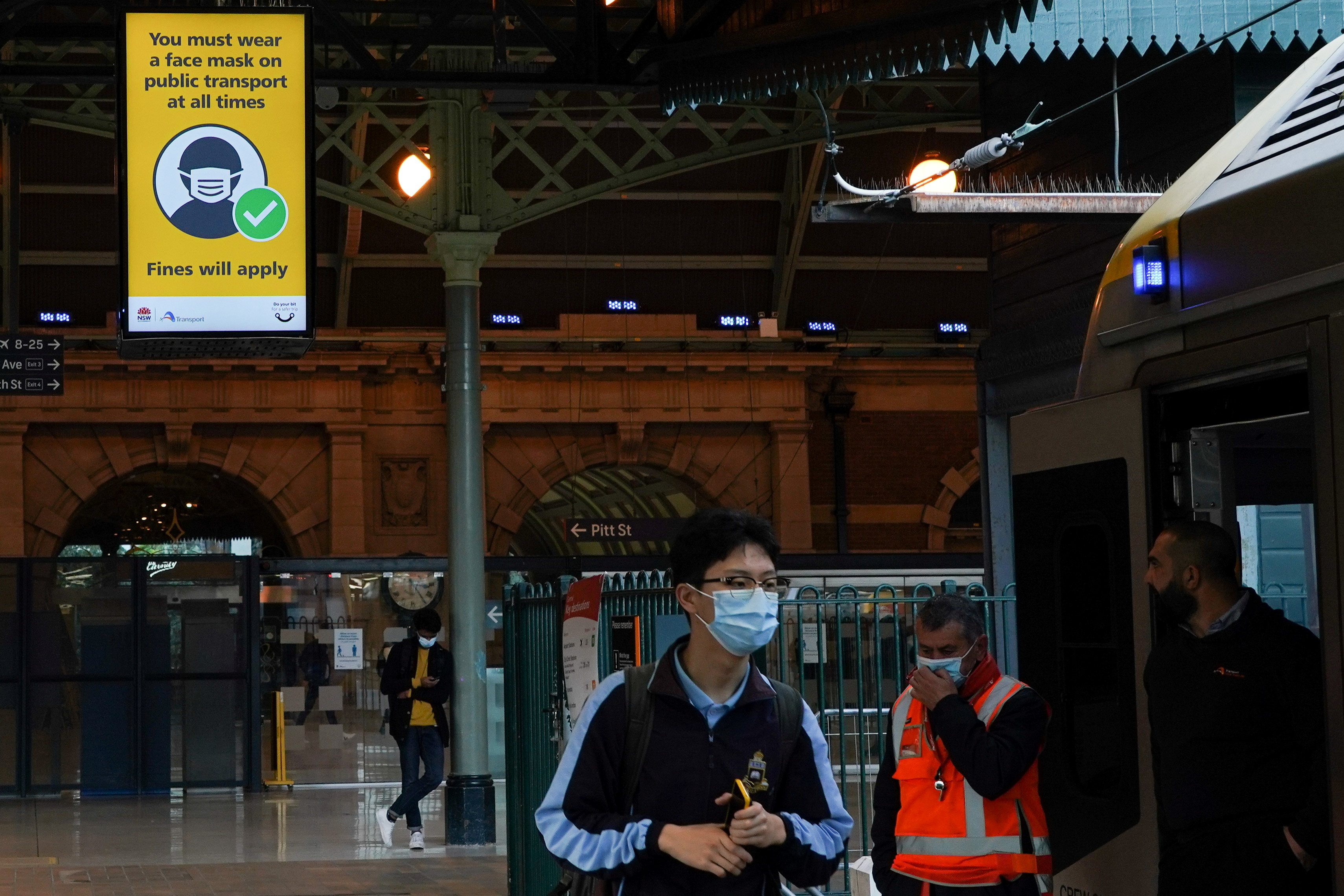A sign at Central Station notes the implementation of new public health regulations from the state of New South Wales, as the city grapples with an outbreak of the coronavirus disease (COVID-19) in Sydney, Australia, June 23, 2021.  REUTERS/Loren Elliott