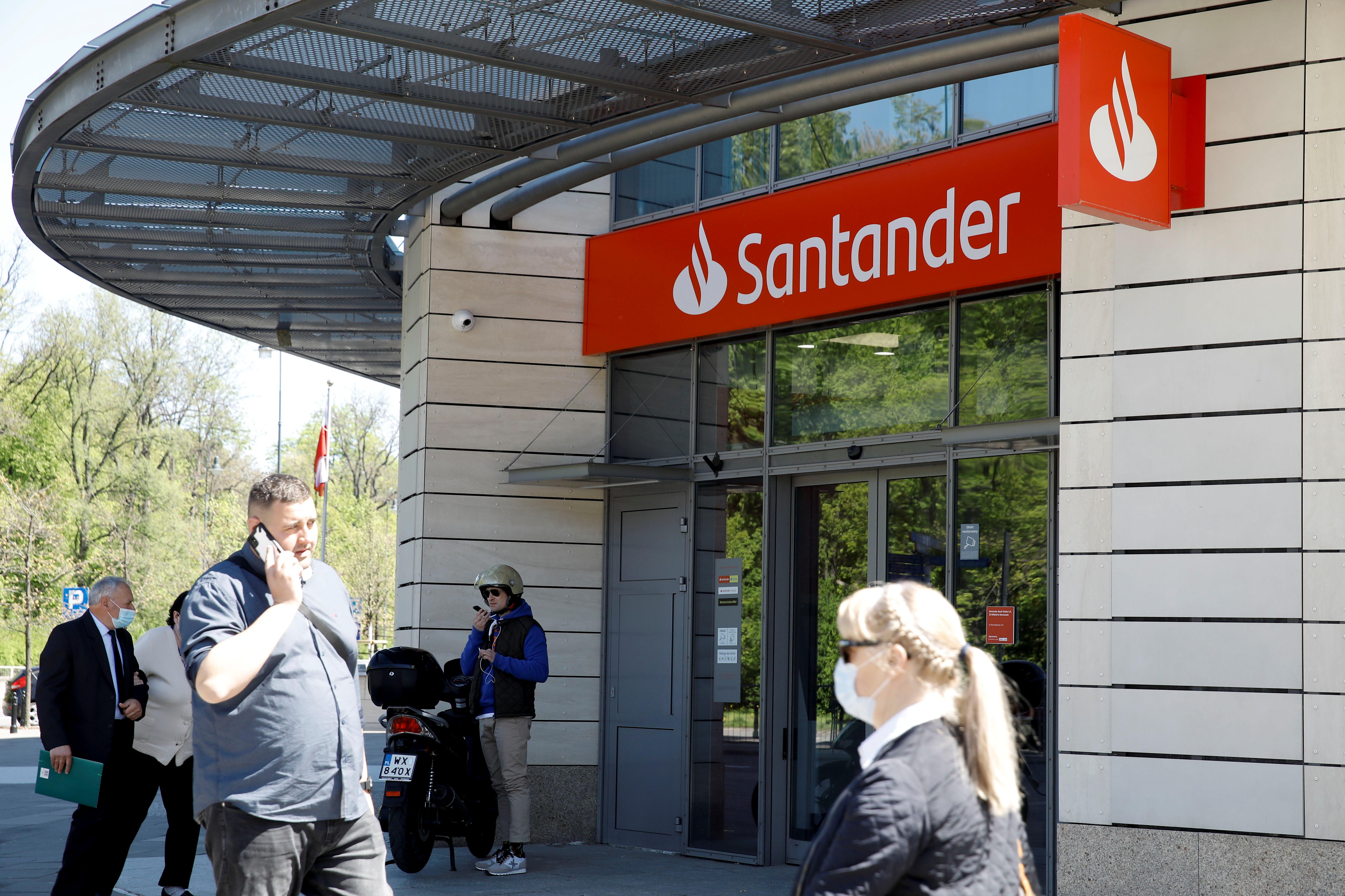 People walk past a branch of the Polish unit of Spain's Santander (Santander Bank Polska), in Warsaw, Poland, May 10, 2021. REUTERS/Kacper Pempel